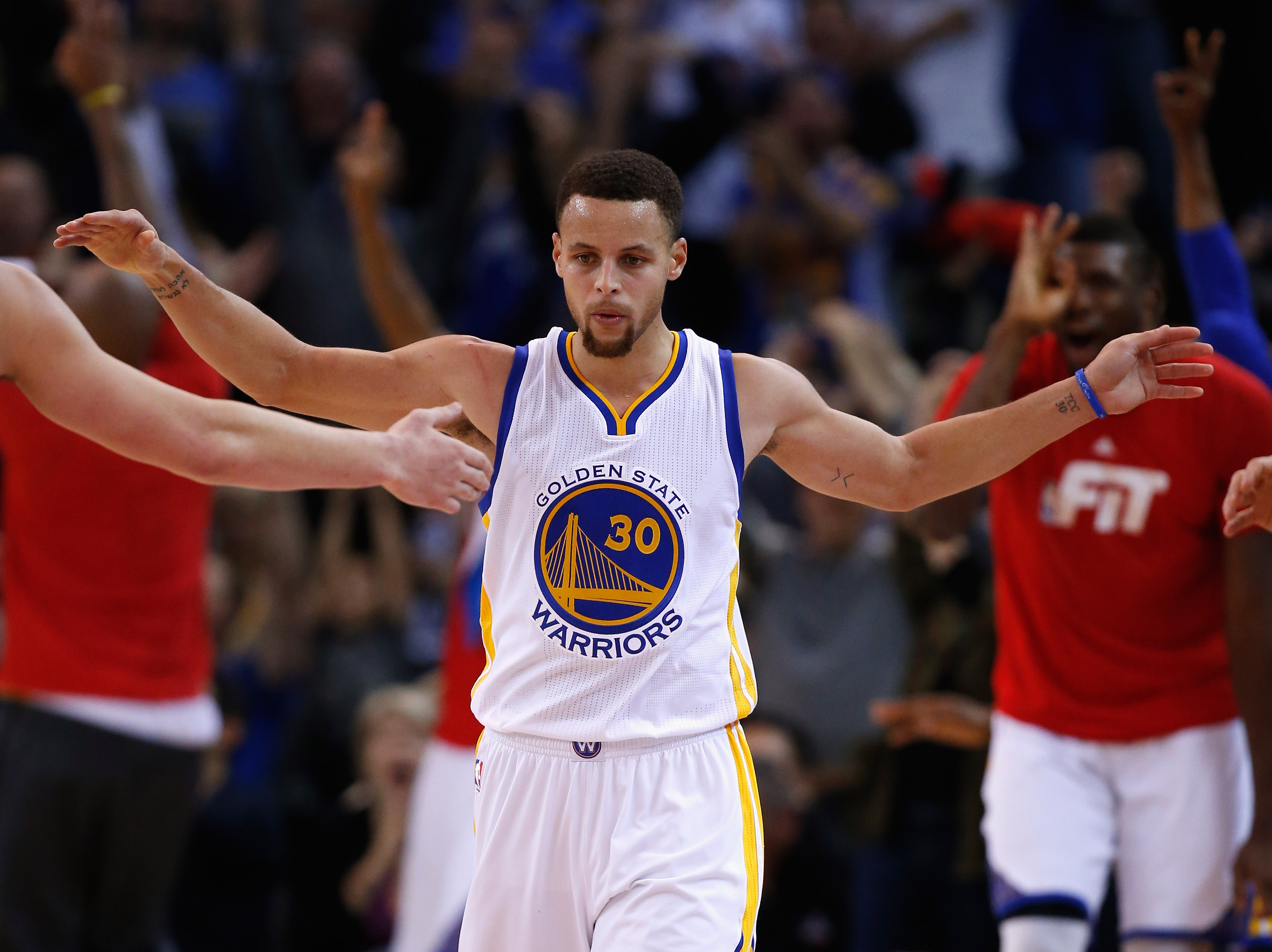 OAKLAND, CA - JANUARY 22:  Stephen Curry #30 of the Golden State Warriors reacts after making a three-point basket against the Indiana Pacers at ORACLE Arena on January 22, 2016 in Oakland, California. (Photo by Ezra Shaw/Getty Images)
