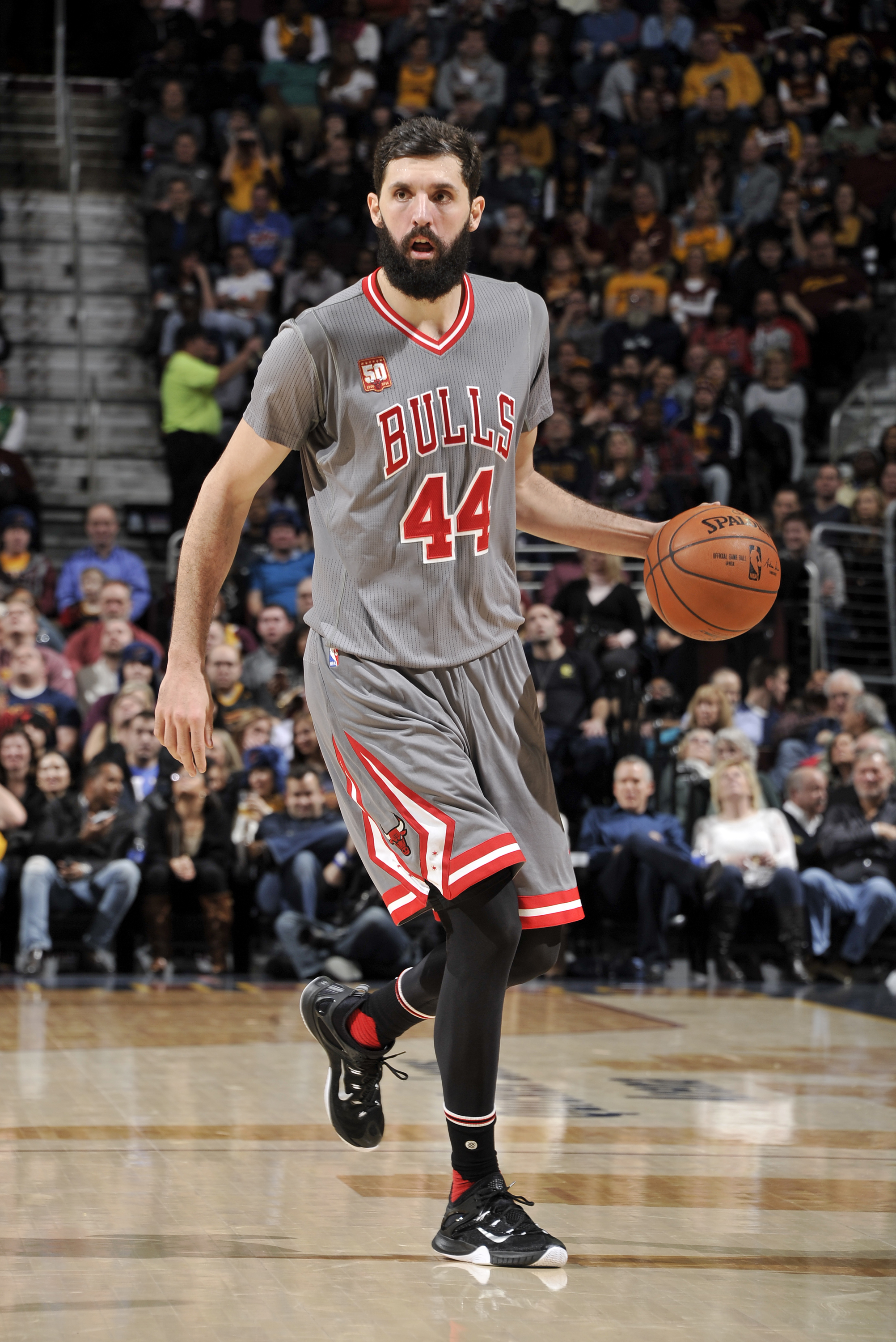 CLEVELAND, OH - JANUARY 23:  Nikola Mirotic #44 of the Chicago Bulls brings the ball up the court against the Cleveland Cavaliers during the game at The Quicken Loans Arena on January 23, 2016 in Cleveland, Ohio. (Photo by David Liam Kyle/NBAE via Getty I