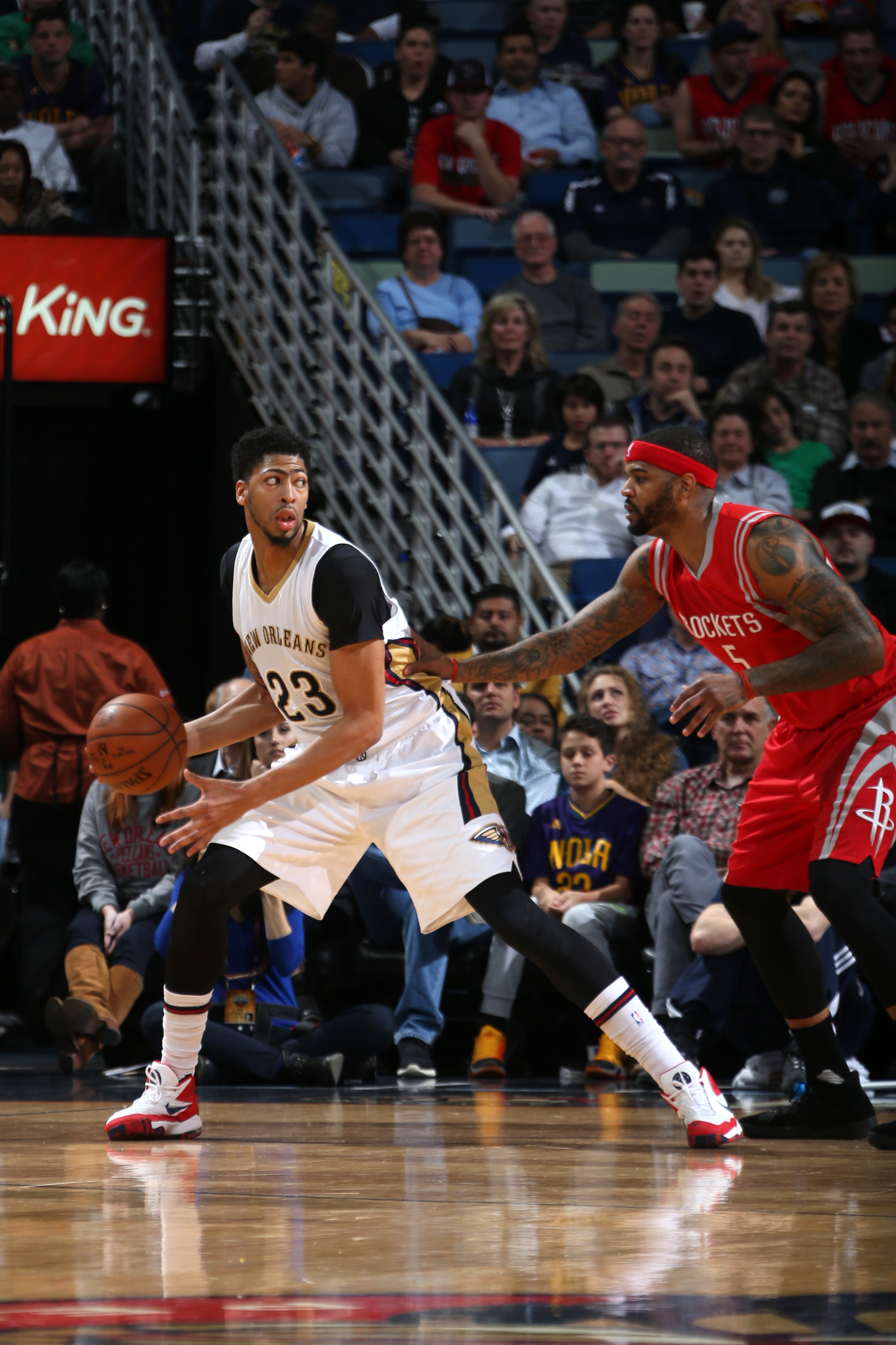 NEW ORLEANS, LA - JANUARY 25:  Anthony Davis #23 of the New Orleans Pelicans handles the ball against Josh Smith #5 of the Houston Rockets on January 25, 2016 at the Smoothie King Center in New Orleans, Louisiana. (Photo by Layne Murdoch Jr./NBAE via Gett