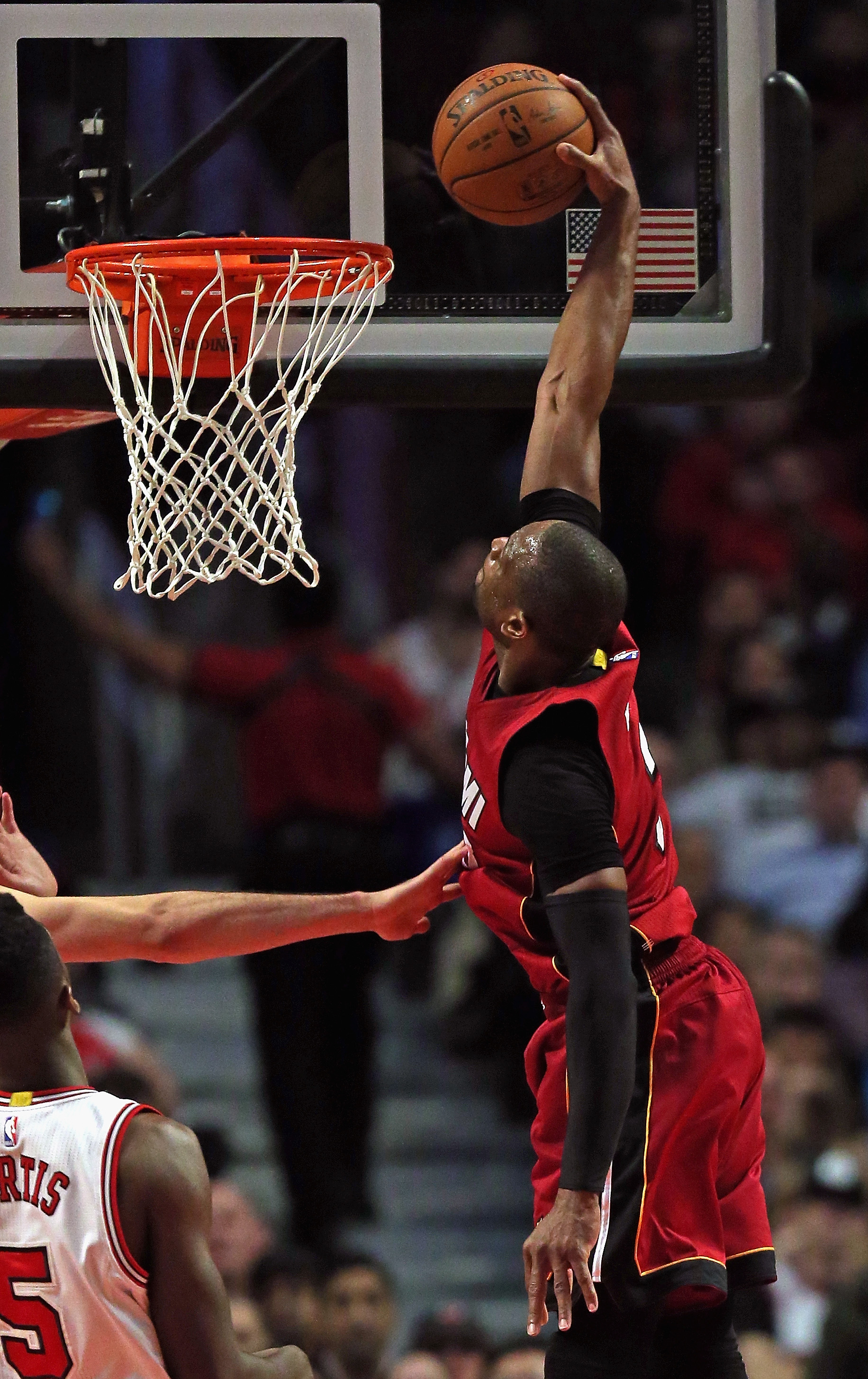 CHICAGO, IL - JANUARY 25:  Dwyane Wade #3 of the Miami Heat dunks aganst the Chicago Bulls at the United Center on January 25, 2016 in Chicago, Illinois. The Heat defeated the Bulls 89-84. (Photo by Jonathan Daniel/Getty Images)