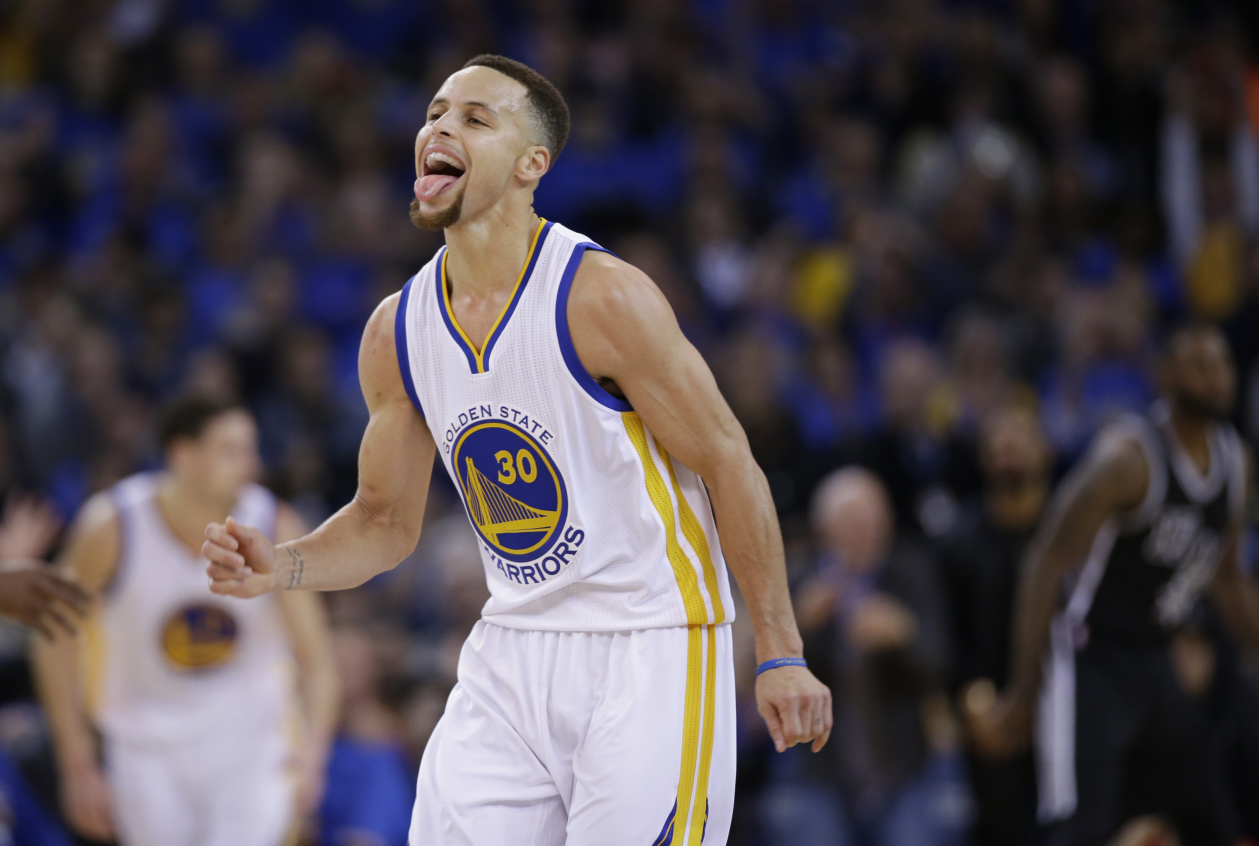 Golden State Warriors' Stephen Curry (30) celebrates after scoring against the San Antonio Spurs during the second half of an NBA basketball game Monday, Jan. 25, 2016, in Oakland, Calif. The Warriors won 120-90. (AP Photo/Marcio Jose Sanchez)