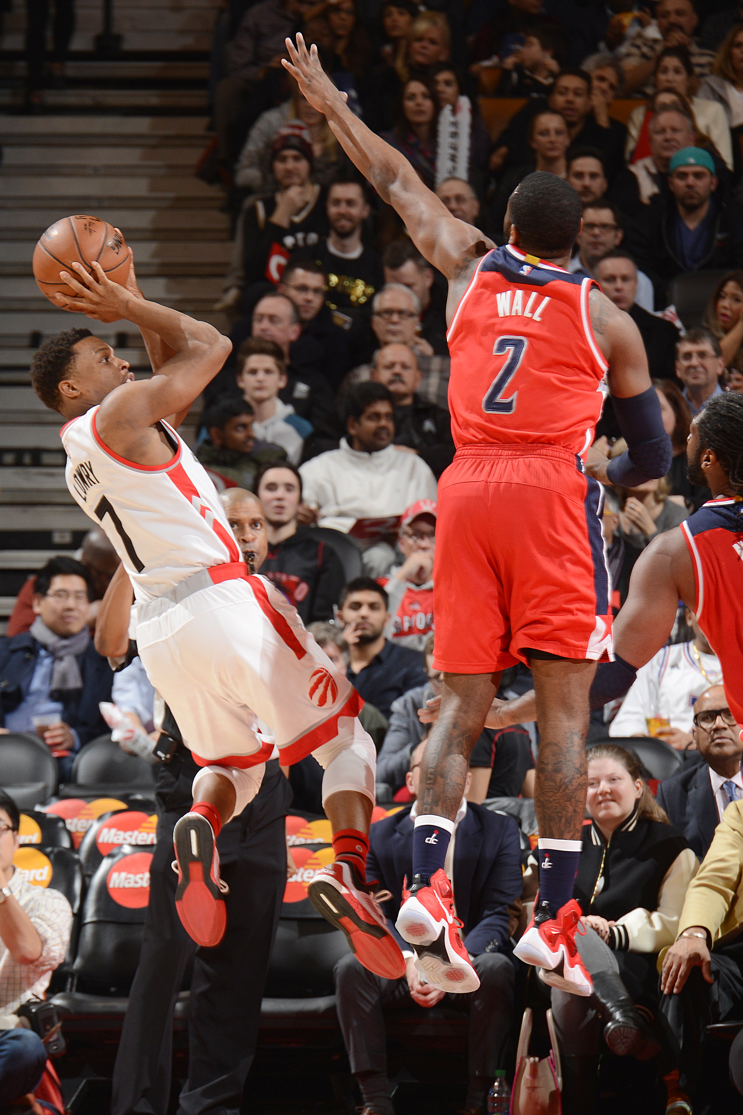 TORONTO, CANADA - JANUARY 26:  Kyle Lowry #7 of the Toronto Raptors shoots the ball against John Wall #2 of the Washington Wizards on January 26, 2016 at the Air Canada Centre in Toronto, Ontario, Canada.  (Photo by Ron Turenne/NBAE via Getty Images)