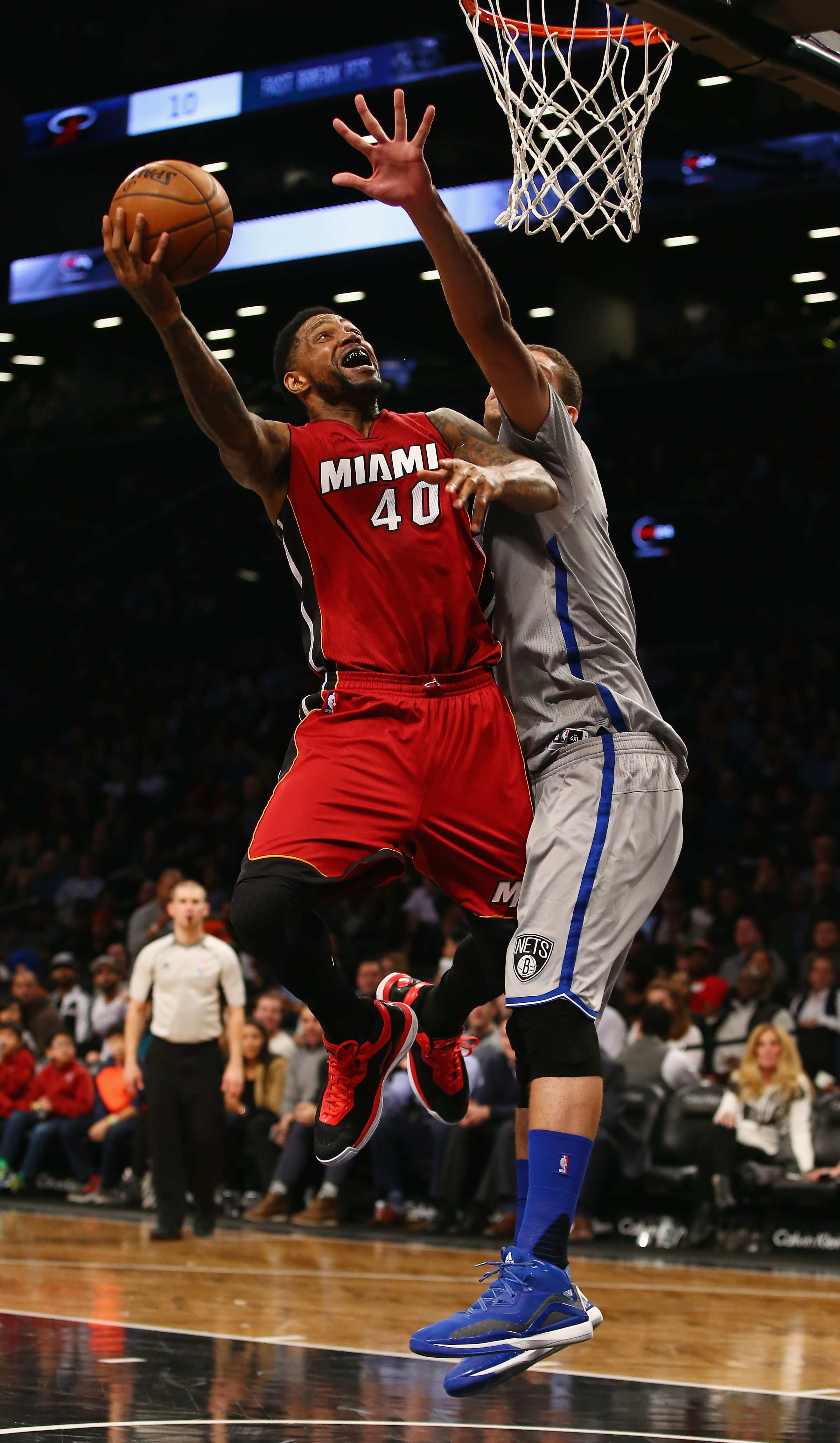 NEW YORK, NY - JANUARY 26:  Udonis Haslem #40 of the Miami Heat shoots agaist Brook Lopez #11 of the Brooklyn Nets during their game at the Barclays Center on January 26, 2016 in New York City.   (Photo by Al Bello/Getty Images)