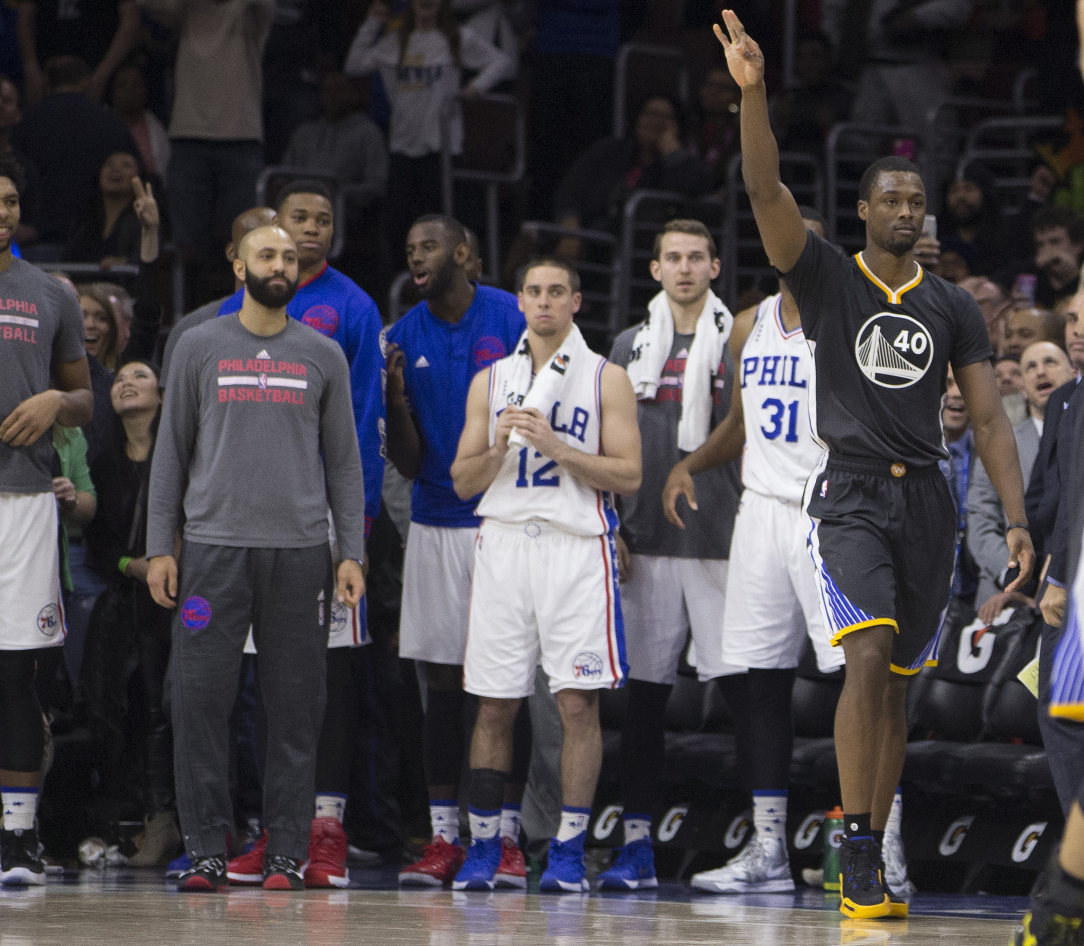 PHILADELPHIA, PA - JANUARY 30: Harrison Barnes #40 of the Golden State Warriors reacts after making the game winning shot in front of the Philadelphia 76ers bench on January 30, 2016 at the Wells Fargo Center in Philadelphia, Pennsylvania. The Warriors de