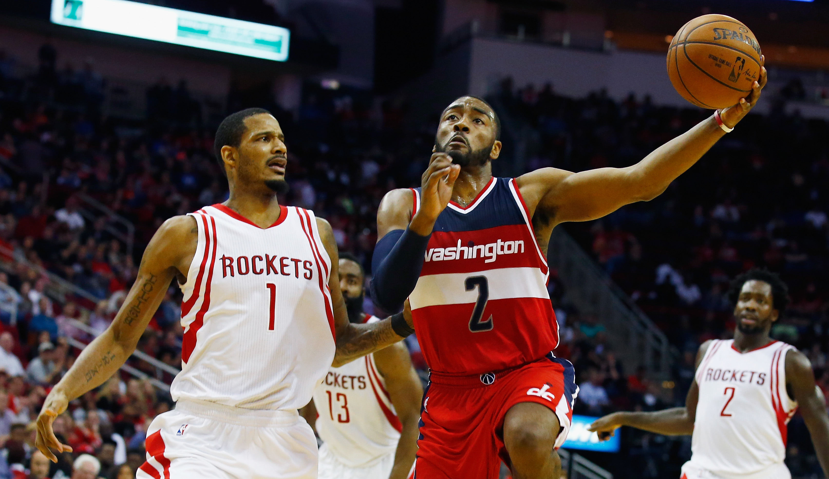 HOUSTON, TX - JANUARY 30:  John Wall #2 of the Washington Wizards drives with the basketball against Trevor Ariza #1 of the Houston Rockets during their game at the Toyota Center on January 30, 2016  in Houston, Texas. (Photo by Scott Halleran/Getty Image