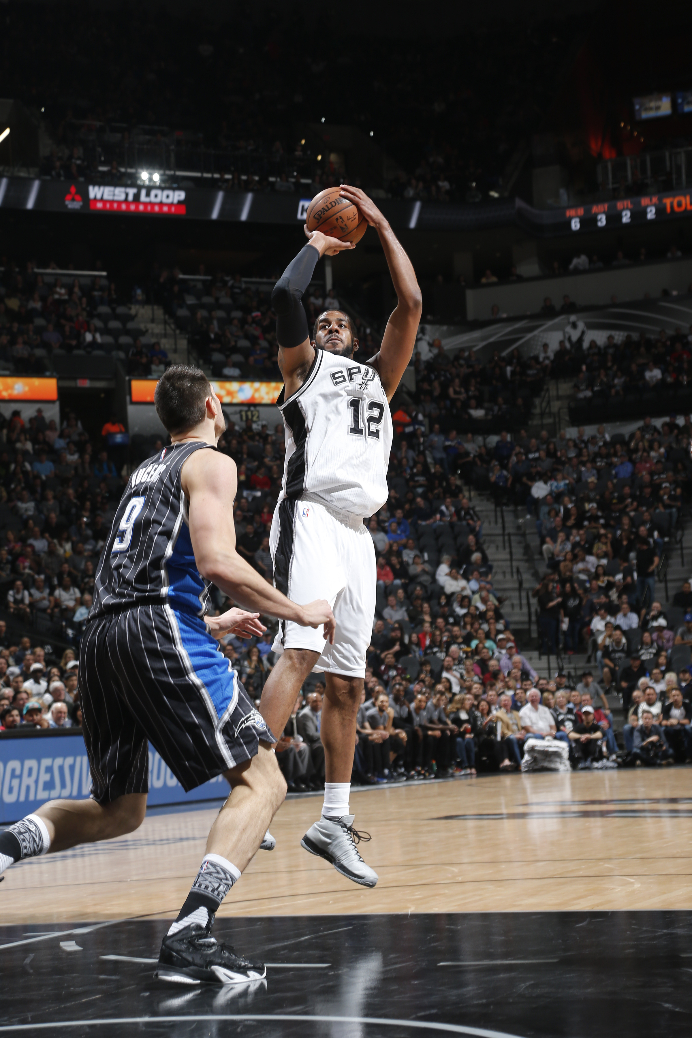 SAN ANTONIO, TX - FEBRUARY 1: LaMarcus Aldridge #12 of the San Antonio Spurs shoots the ball against the Orlando Magic on February 1, 2016 at the AT&T Center in San Antonio, Texas.