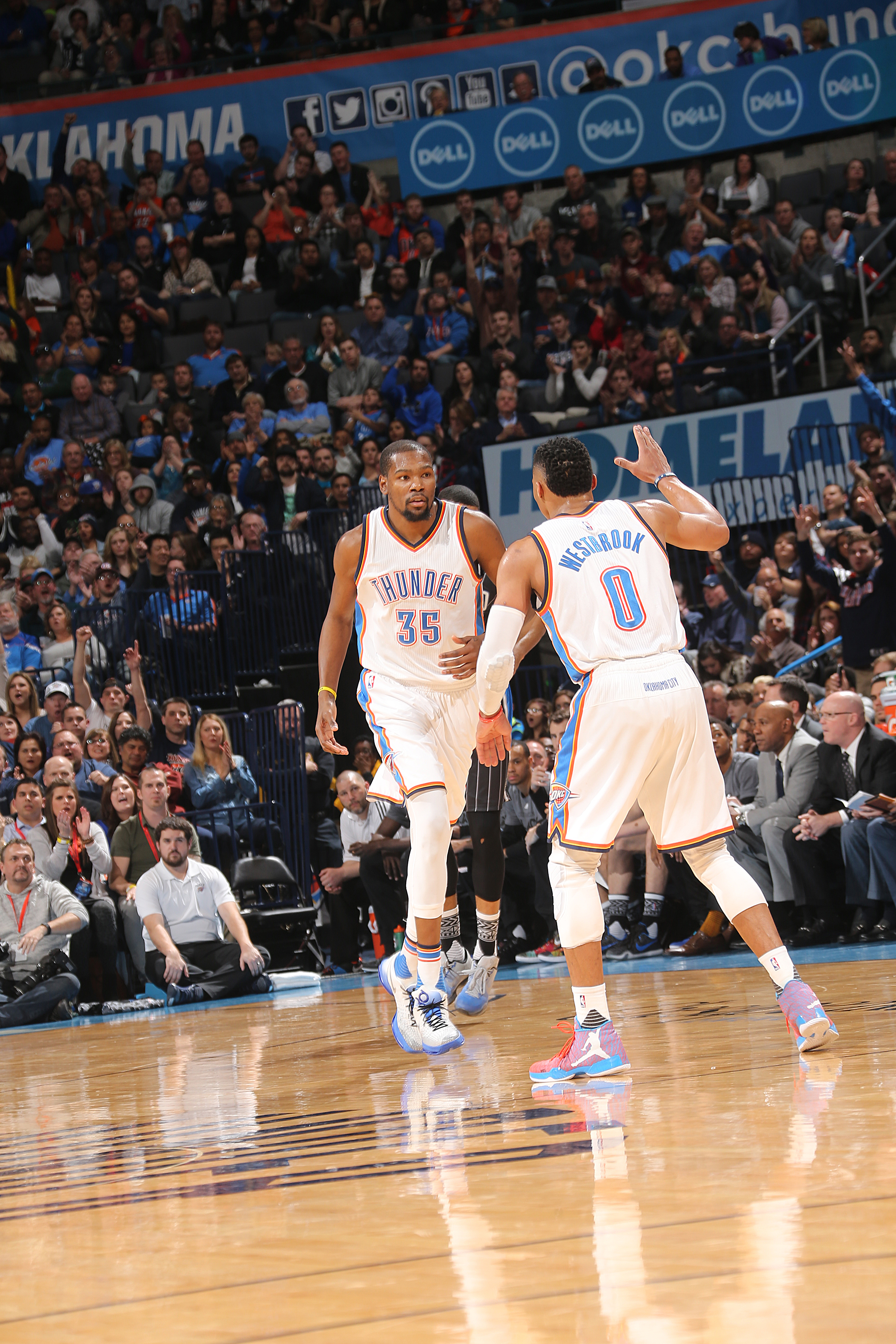 OKLAHOMA CITY, OK- FEBRUARY 3:  Kevin Durant #35 of the Oklahoma City Thunder celebrates with Russell Westbrook #0 of the Oklahoma City Thunder during the game against the Orlando Magic on February 3, 2016 at Chesapeake Energy Arena in Oklahoma City, Okla