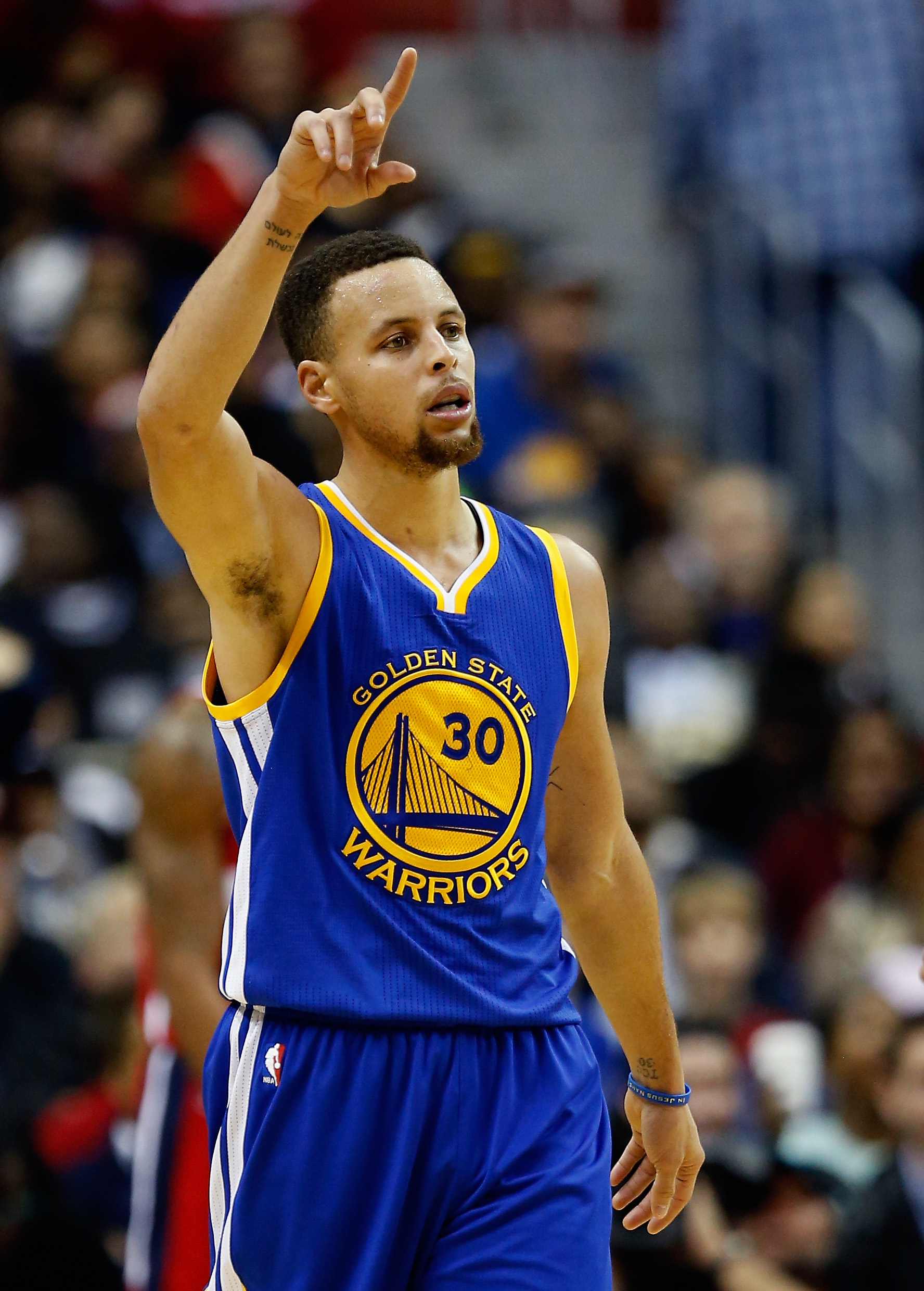 WASHINGTON, DC - FEBRUARY 03:  Stephen Curry #30 of the Golden State Warriors celebrates after scoring in the foiurth quarter against the Washington Wizards at Verizon Center on February 3, 2016 in Washington, DC. The Warriors defeated the Wizards 134 to