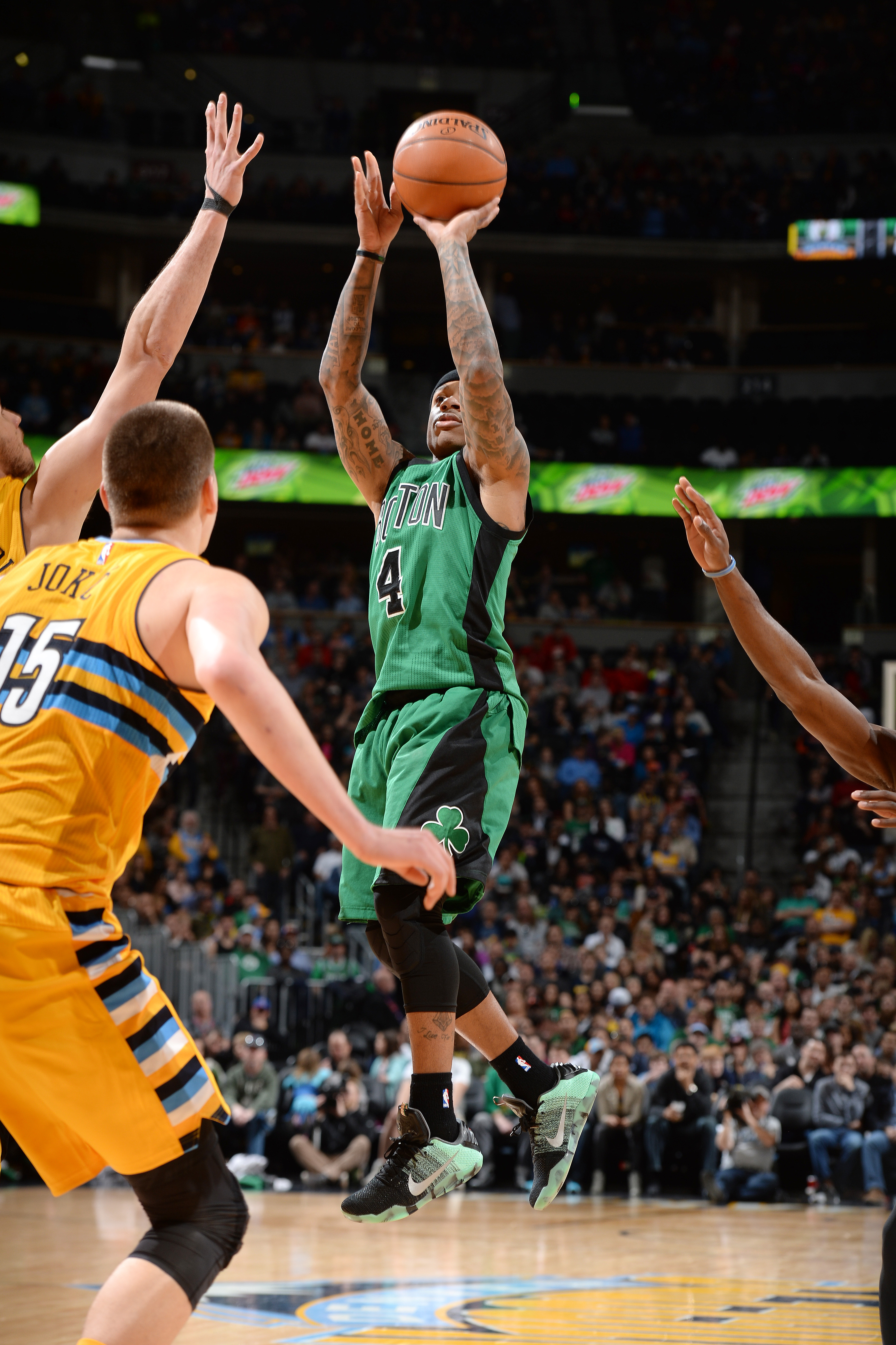 DENVER, CO - FEBRUARY 21: Isaiah Thomas #4 of the Boston Celtics shoots the ball during the game against the Denver Nuggets on February 21, 2016 at the Pepsi Center in Denver, Colorado. (Photo by Garrett Ellwood/NBAE via Getty Images)