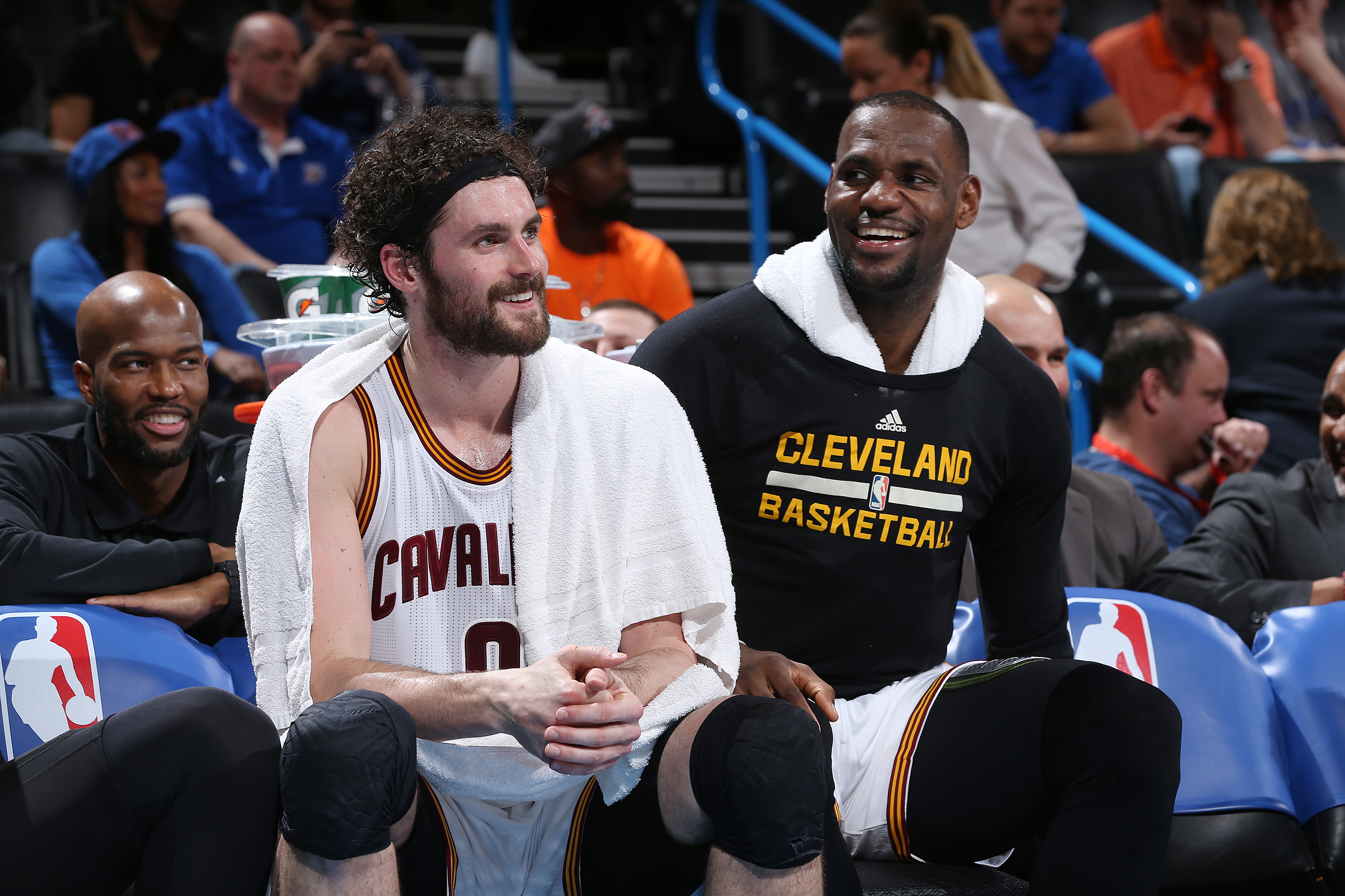 OKLAHOMA CITY, OK- FEBRUARY 21:  Kevin Love #0 of the Cleveland Cavaliers and LeBron James #23 of the Cleveland Cavaliers talk on the bench during the game against the Oklahoma City Thunder on February 21, 2016 at Chesapeake Energy Arena in Oklahoma City,