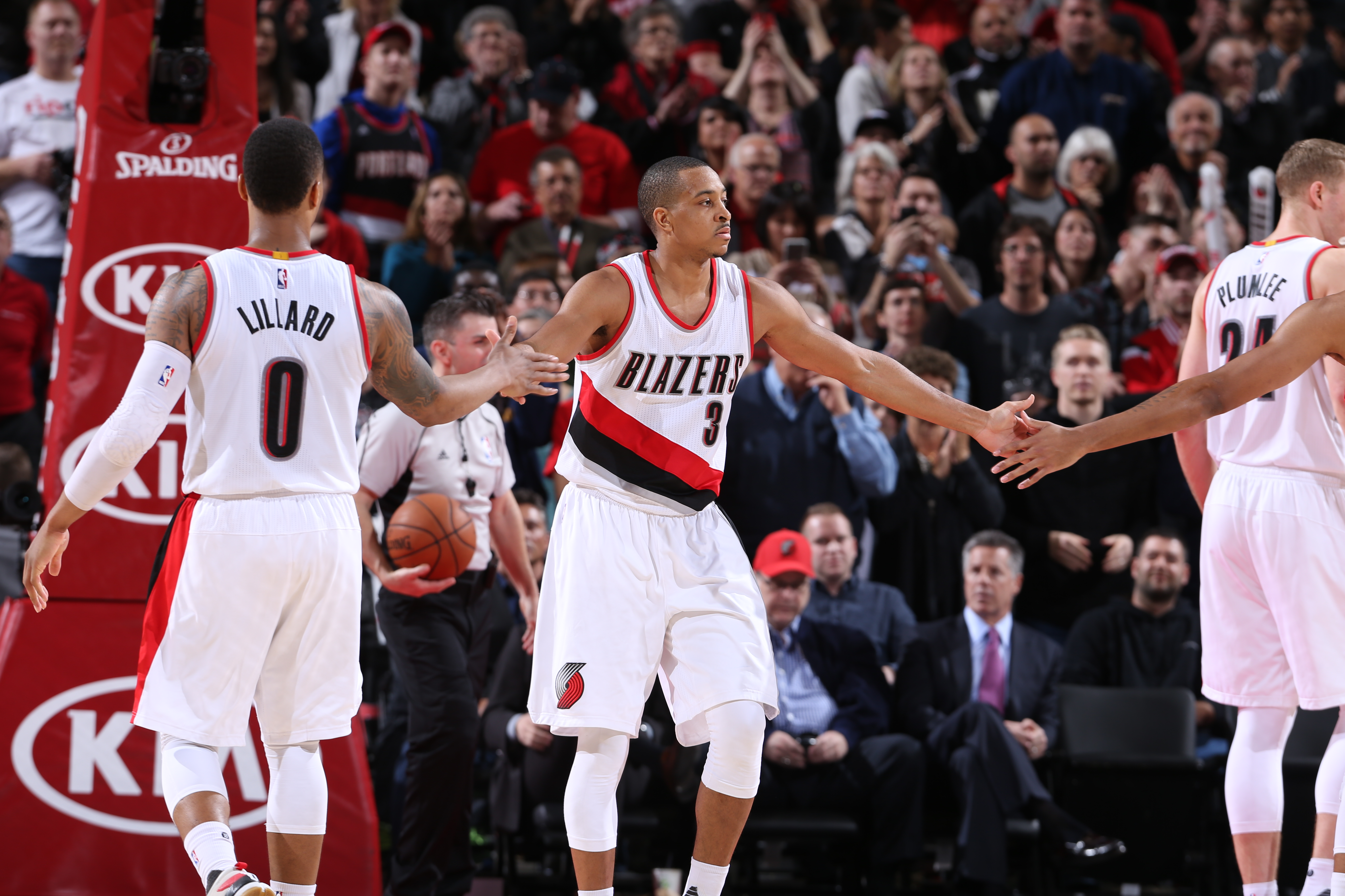 PORTLAND, OR - FEBRUARY 21:  C.J. McCollum #3 of the Portland Trail Blazers high fives teammate sagainst the Utah Jazz on February 21, 2016 at the Moda Center in Portland, Oregon. (Photo by Sam Forencich/NBAE via Getty Images)