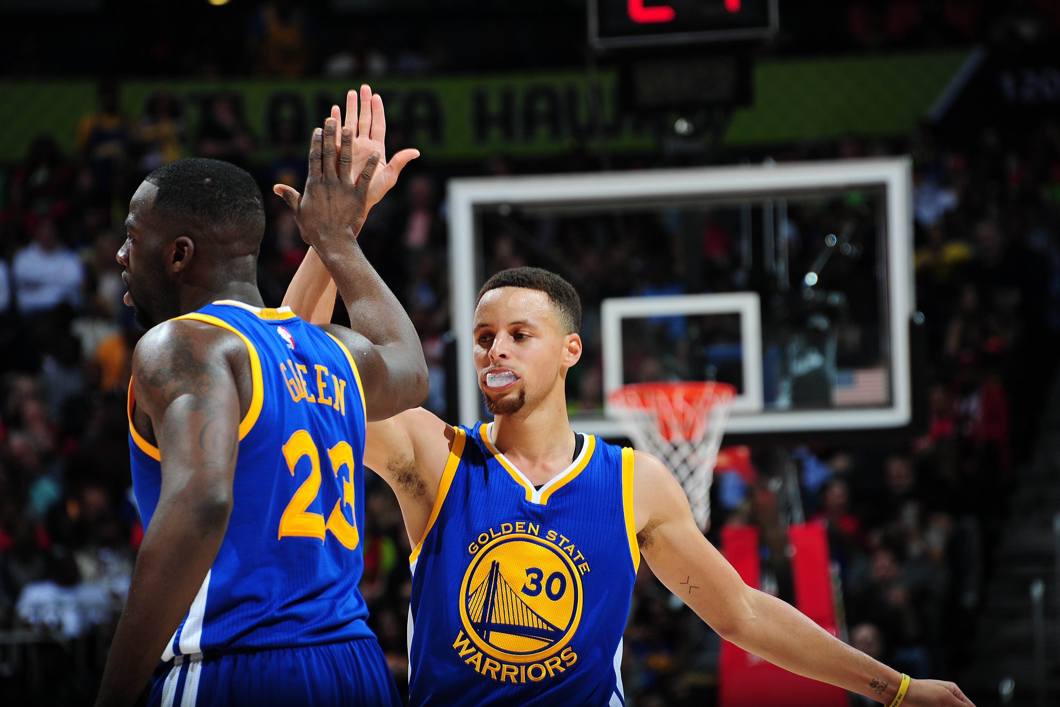 ATLANTA, GA - FEBRUARY 22:  Stephen Curry #30 of the Golden State Warriors shakes hands with Draymond Green #23 of the Golden State Warriors during the game against the Atlanta Hawks on February 22, 2016 at Philips Center in Atlanta, Georgia.  (Photo by S