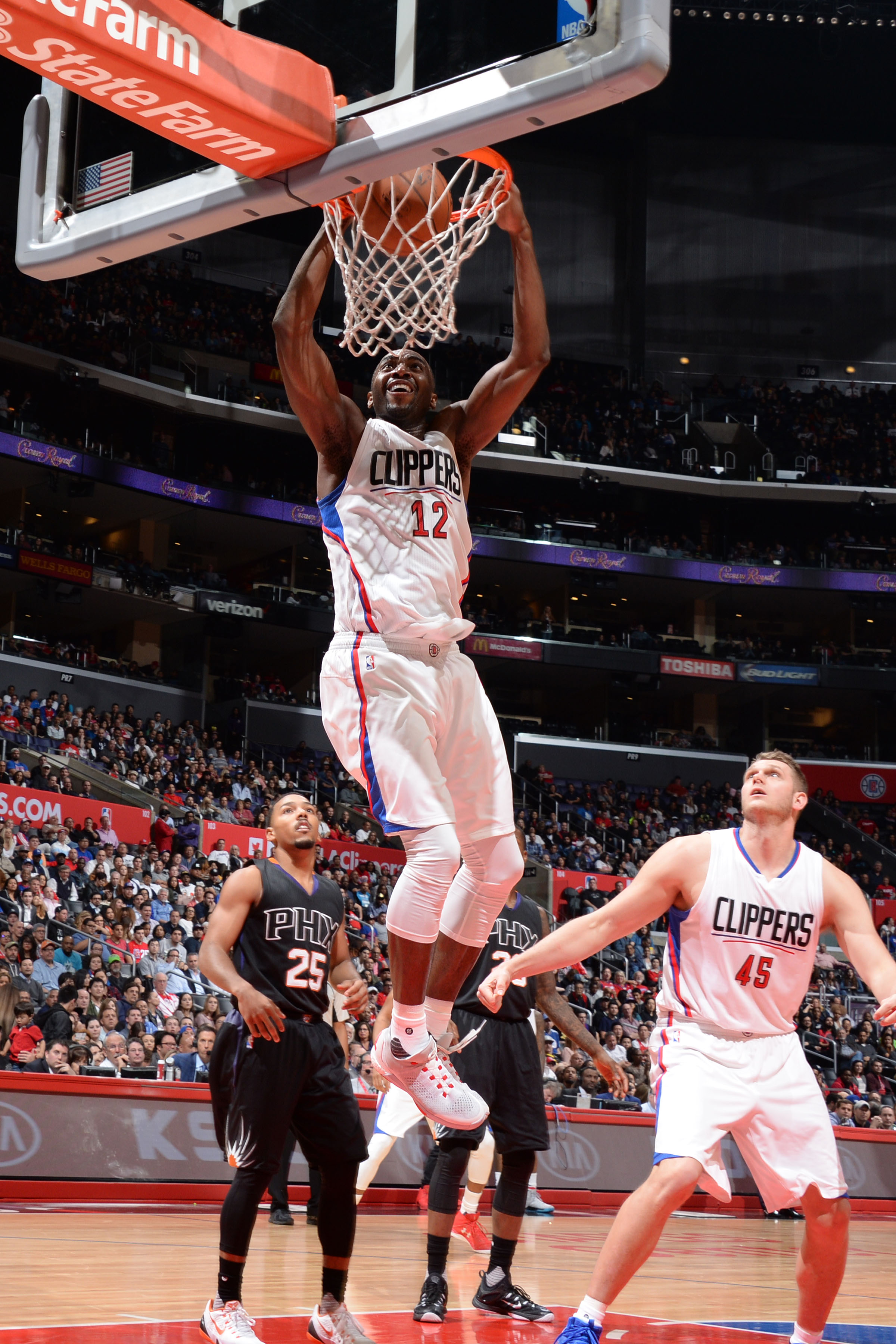 LOS ANGELES, CA - FEBRUARY 22:  Luc Richard Mbah a Moute #12 of the Los Angeles Clippers' dunks against the Phoenix Suns  on February 22, 2016 at STAPLES Center in Los Angeles, California. (Photo by Andrew D. Bernstein/NBAE via Getty Images)