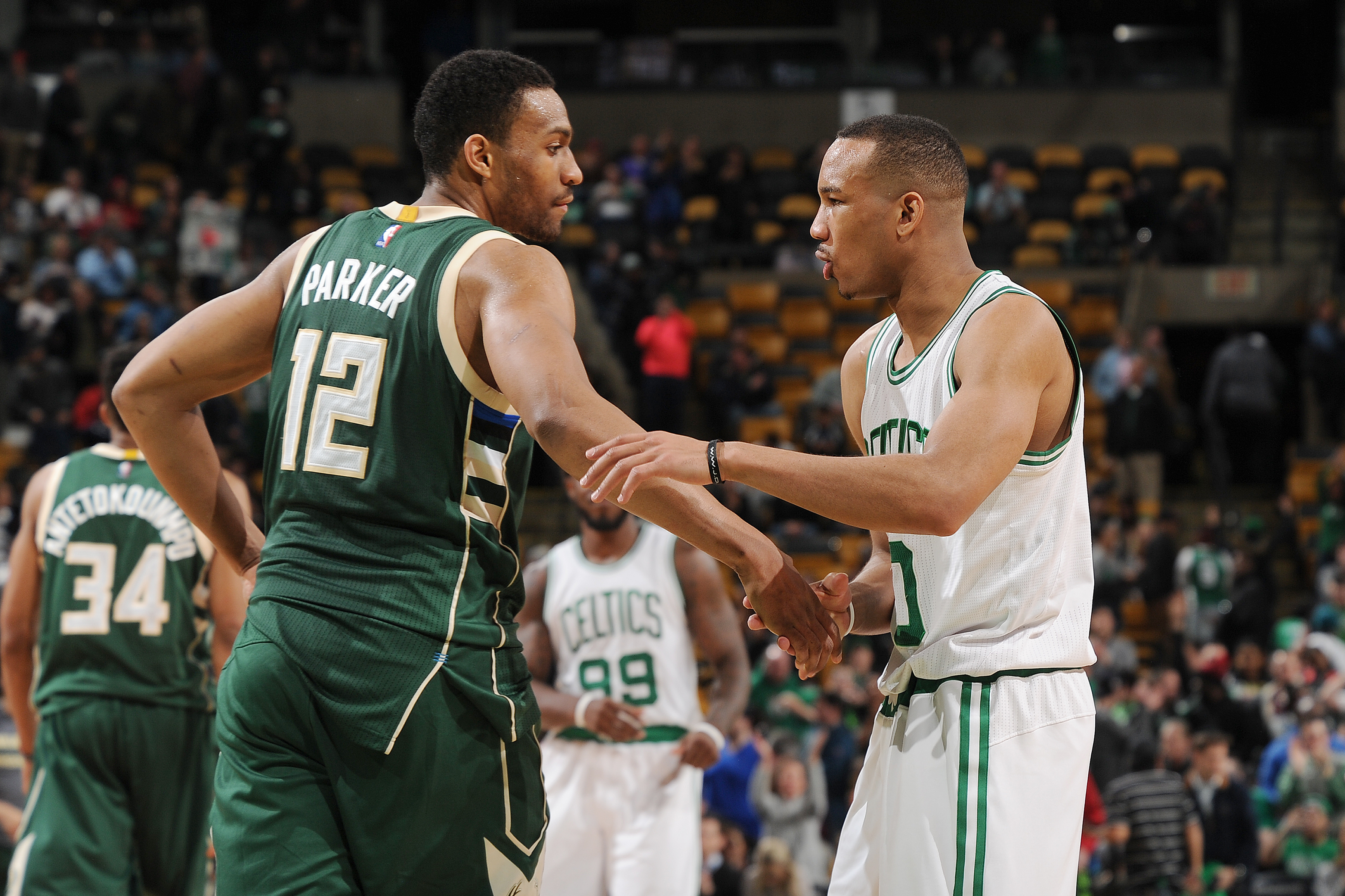 BOSTON, MA - FEBRUARY 25:  Jabari Parker #12 of the Milwaukee Bucks shakes hands with Avery Bradley #0 of the Boston Celtics after the game on February 25, 2016 at the TD Garden in Boston, Massachusetts.  (Photo by Steve Babineau/NBAE via Getty Images)