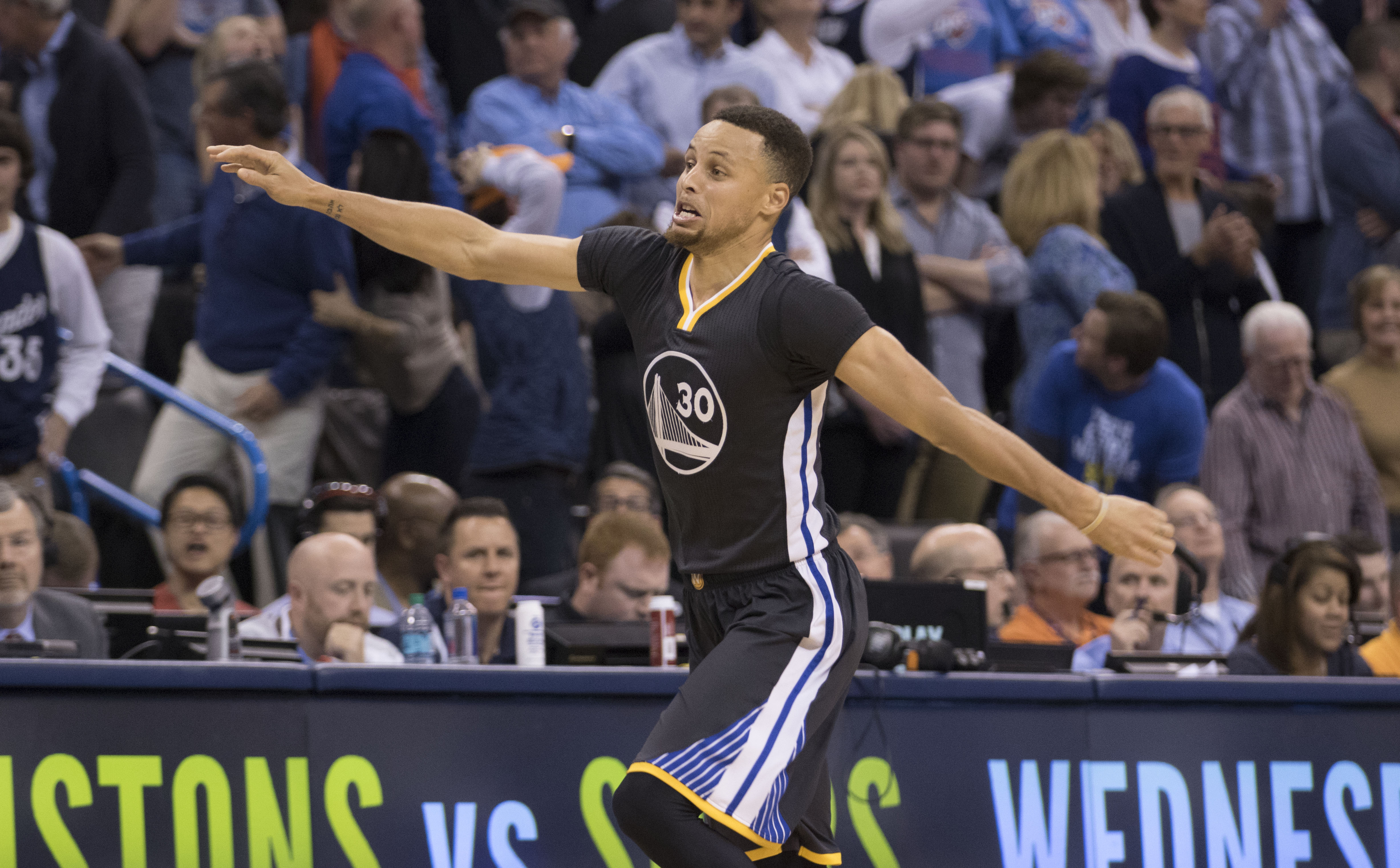 OKLAHOMA CITY, OK - FEBRUARY 27: After scoring the winning three-point shot Stephen Curry #30 of the Golden State Warriors celebrates during the overtime period of a NBA game against the Oklahoma City Thunder at the Chesapeake Energy Arena on February 27,