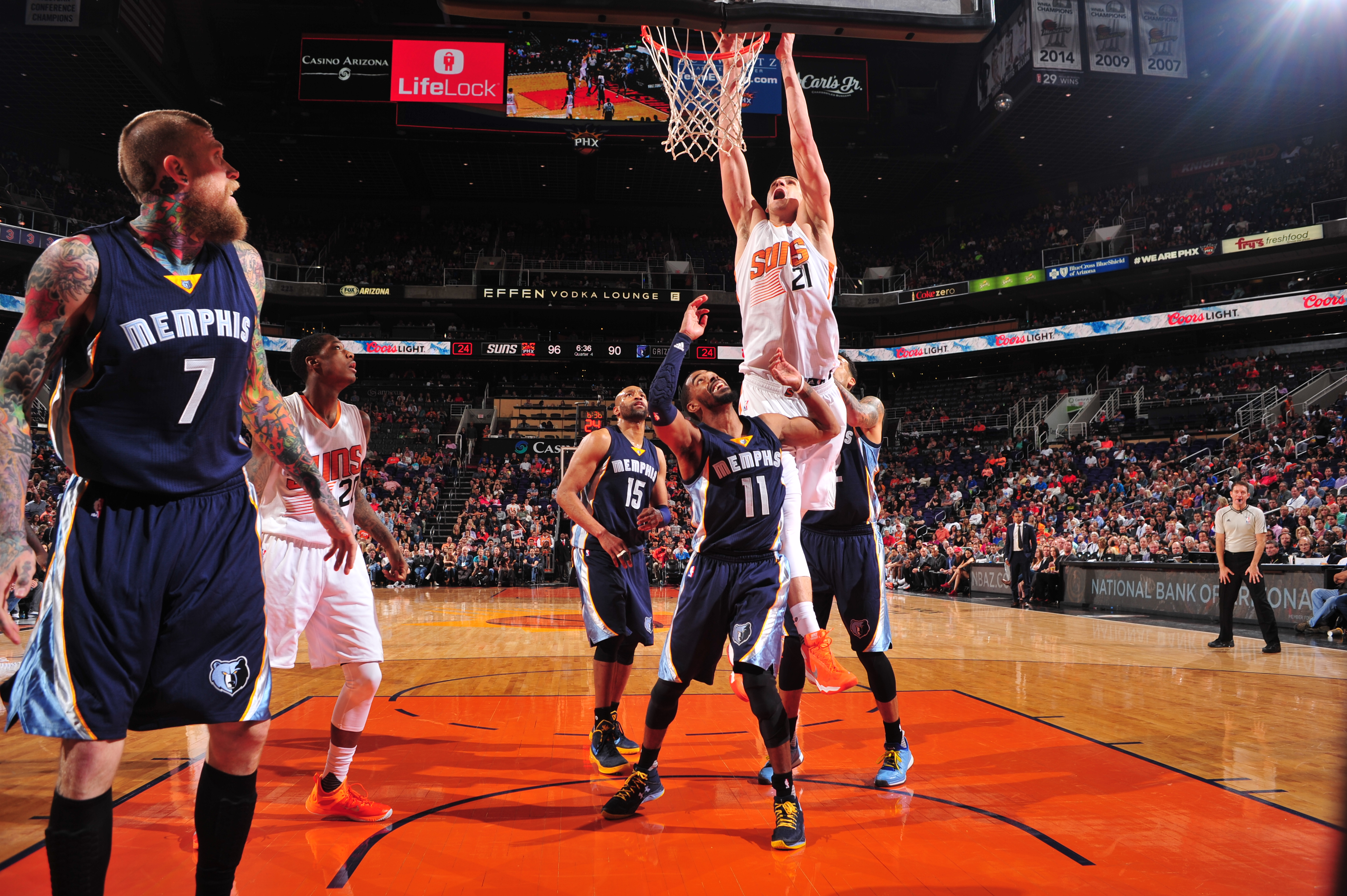 PHOENIX, AZ - FEBRUARY 27:  Alex Len #21 of the Phoenix Suns goes to the basket against the Memphis Grizzlies on February 27, 2016 at Talking Stick Resort Arena in Phoenix, Arizona. (Photo by Barry Gossage/NBAE via Getty Images)