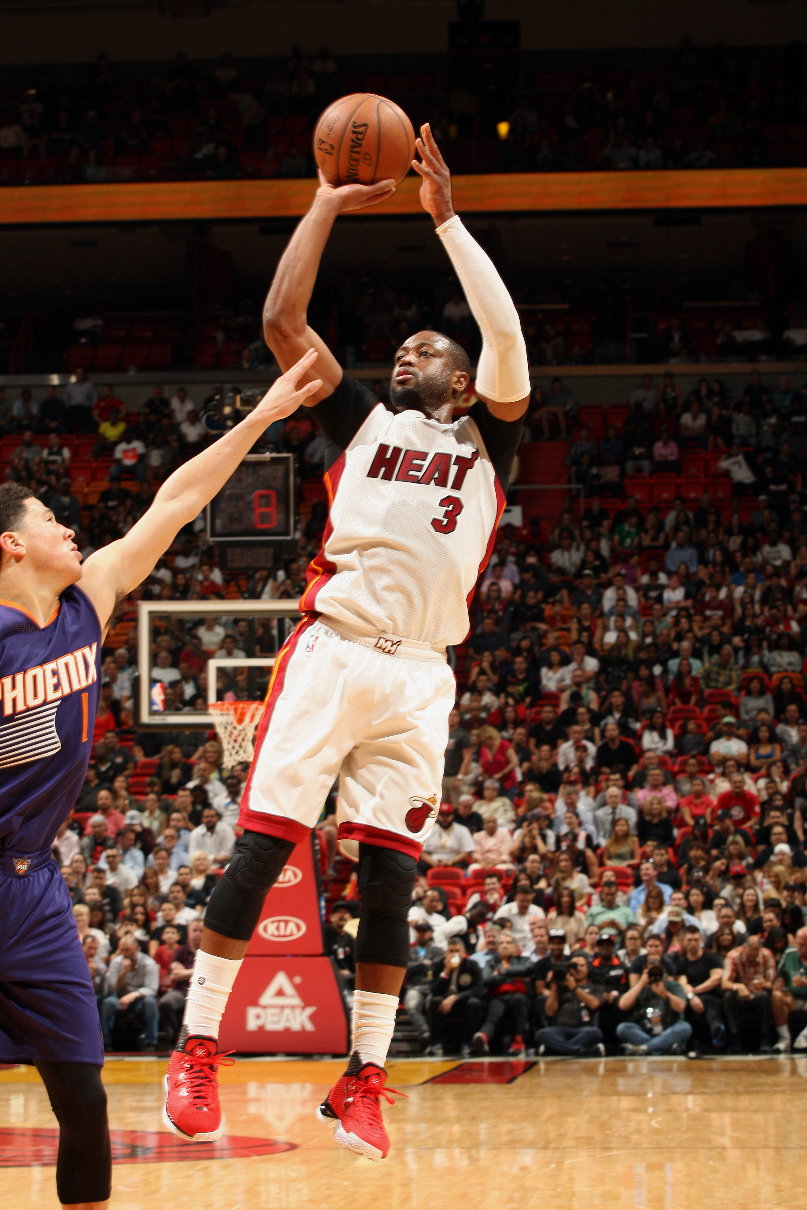 MIAMI, FL  - MARCH 3: Dwyane Wade #3 of the Miami Heat shoots against the Phoenix Suns during the game on March 3, 2016 at American Airlines Arena in Miami, Florida. (Photo by Oscar Baldizon/NBAE via Getty Images)