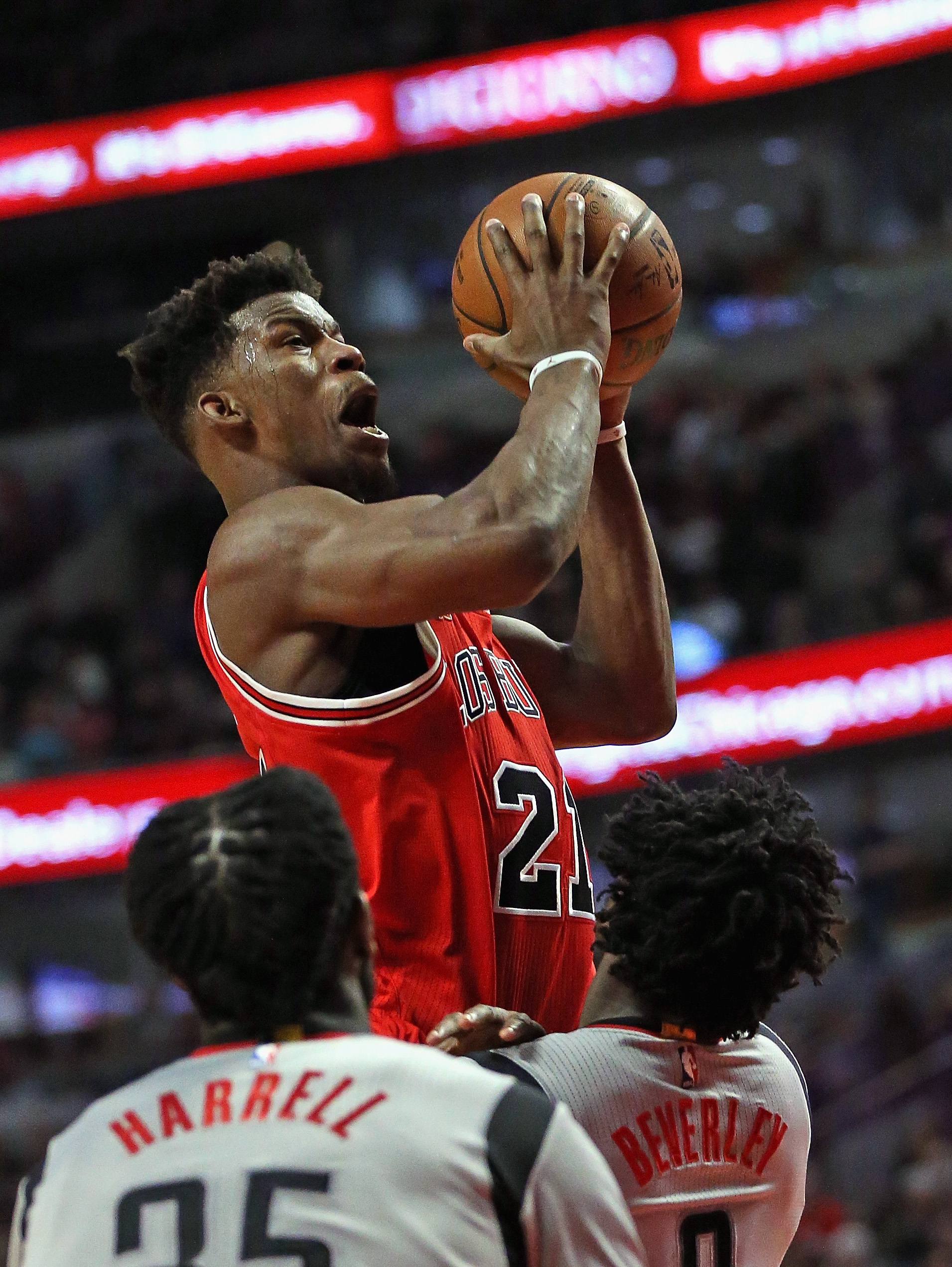 CHICAGO, IL - MARCH 05: Jimmy Butler #21 of the Chicago Bulls goes up for a shot but is called for a charge against Patrick Beverley #2 of the Houston Rockets at the United Center on March 5, 2016 in Chicago, Illinois. The Bulls defeated the Rockets 108-1