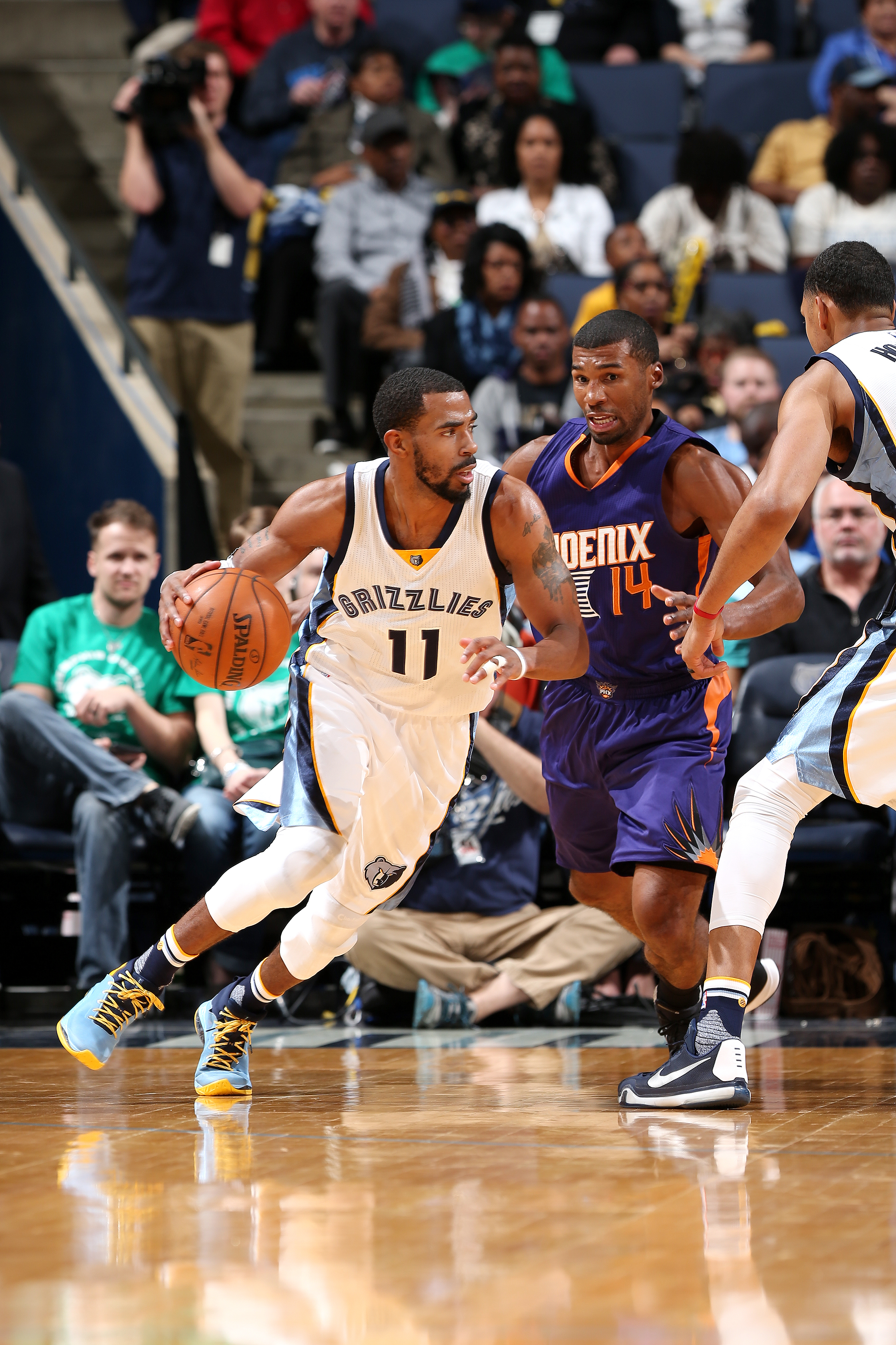 MEMPHIS, TN - MARCH 6: Mike Conley #11 of the Memphis Grizzlies handles the ball during the game against the Phoenix Suns on March 6, 2016 at FedExForum in Memphis, Tennessee. (Photo by Joe Murphy/NBAE via Getty Images)
