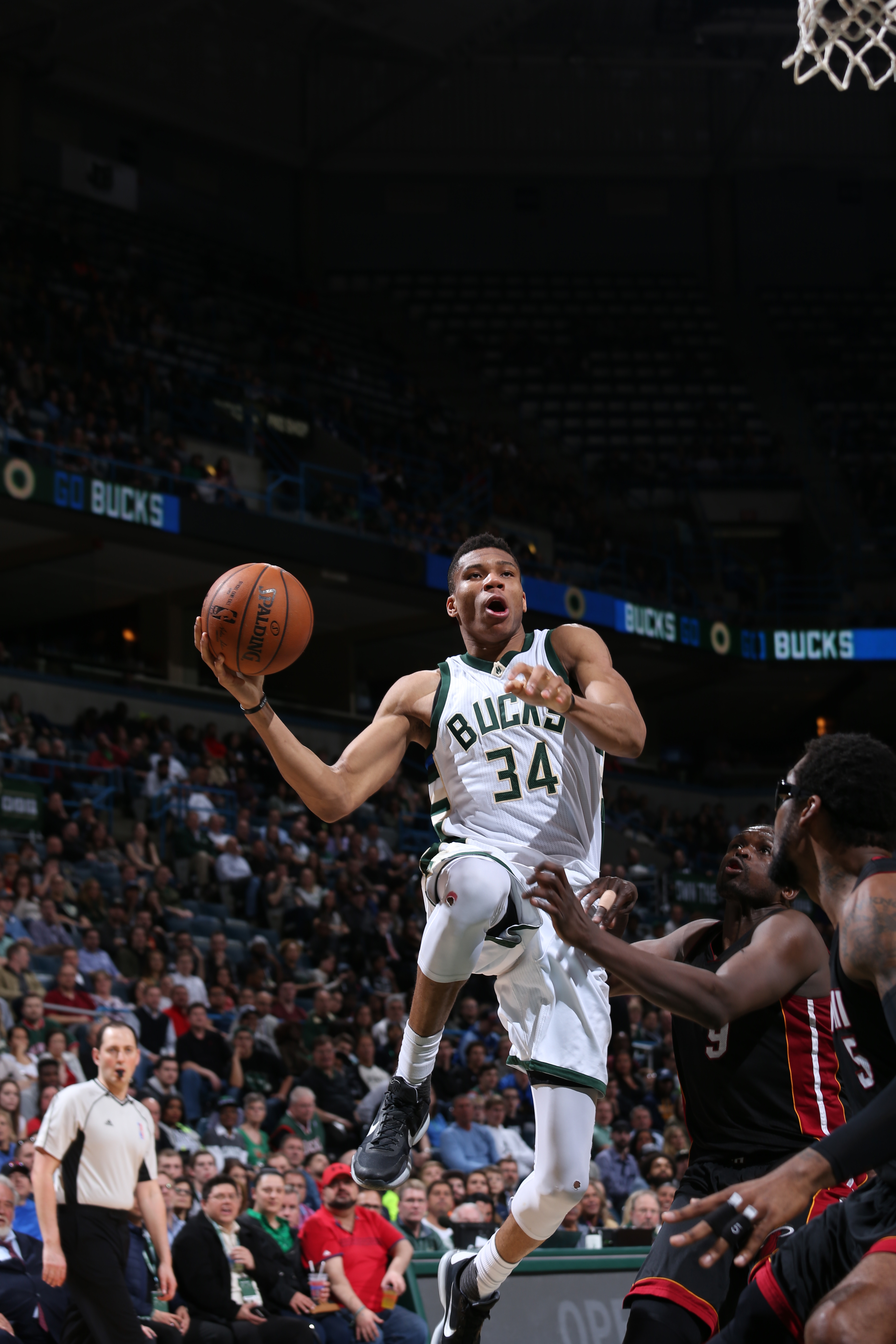 MILWAUKEE, WI  - MARCH 9: Giannis Antetokounmpo #34 of the Milwaukee Bucks goes for the lay up against the Miami Heat during the game on March 9, 2016 at BMO Harris Bradley Center in Milwaukee, Wisconsin. (Photo by Gary Dineen/NBAE via Getty Images)