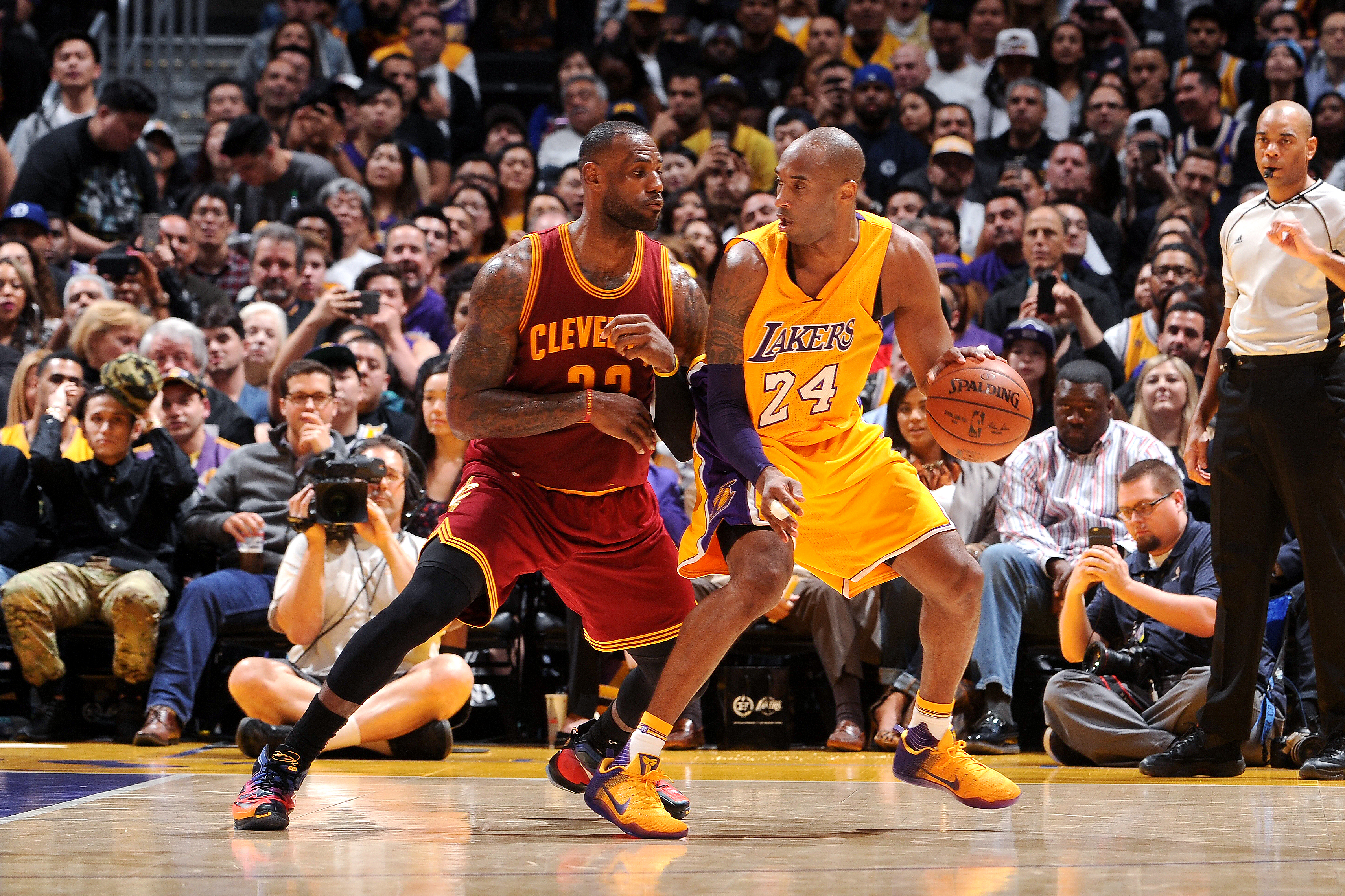 LOS ANGELES, CA - MARCH 10: Kobe Bryant #24 of the Los Angeles Lakers handles the ball during the game against LeBron James #23 of the Cleveland Cavaliers on March 10, 2016 at STAPLES Center in Los Angeles, California. (Photo by Noah Graham/NBAE via Getty