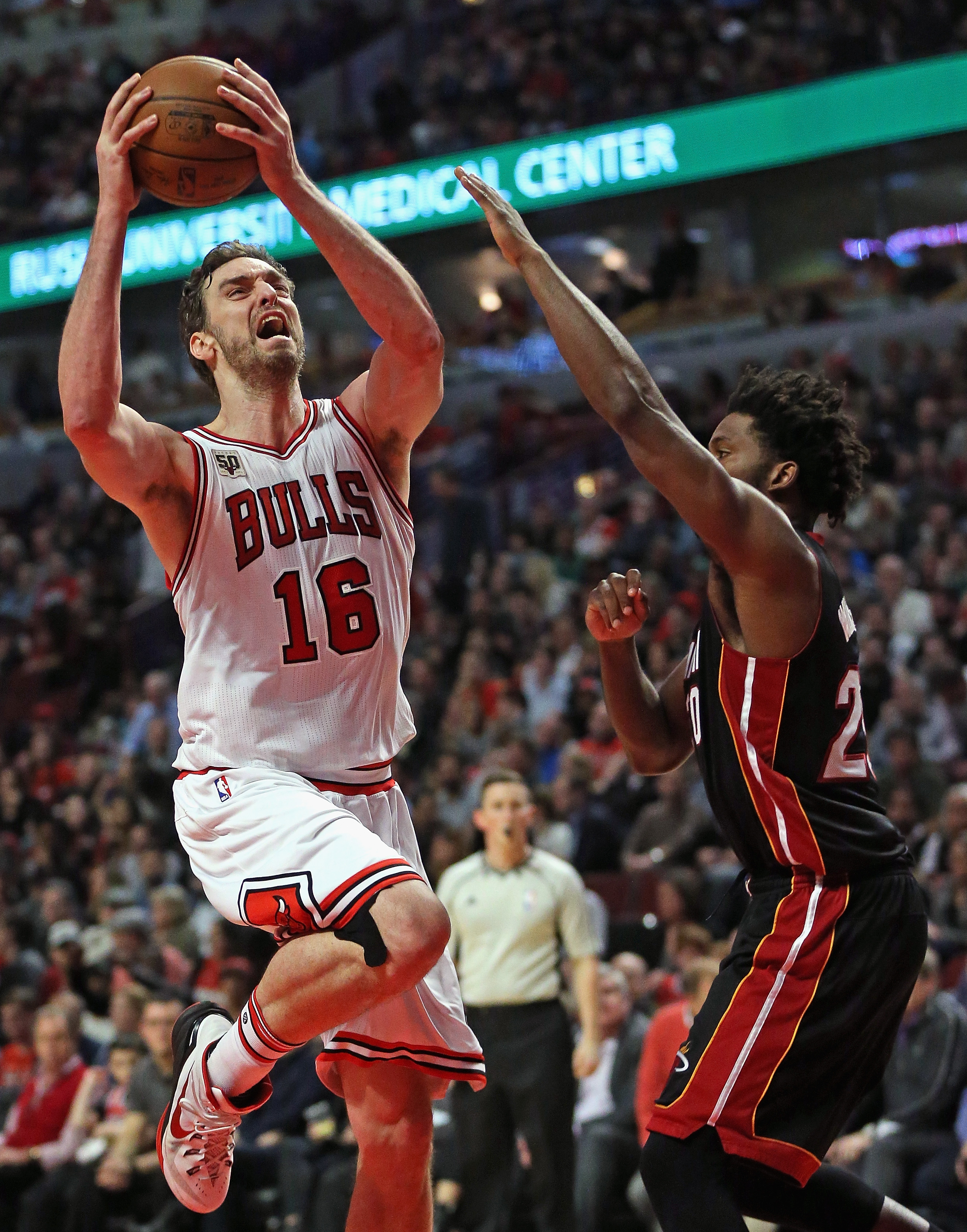 CHICAGO, IL - MARCH 11: Pau Gasol #16 of the Chicago Bulls goes up for a shot past Justise Winslow #20 of the Miami Heat at the United Center on March 11, 2016 in Chicago, Illinois. The Heat defeated the Bulls 118-96. (Photo by Jonathan Daniel/Getty Image