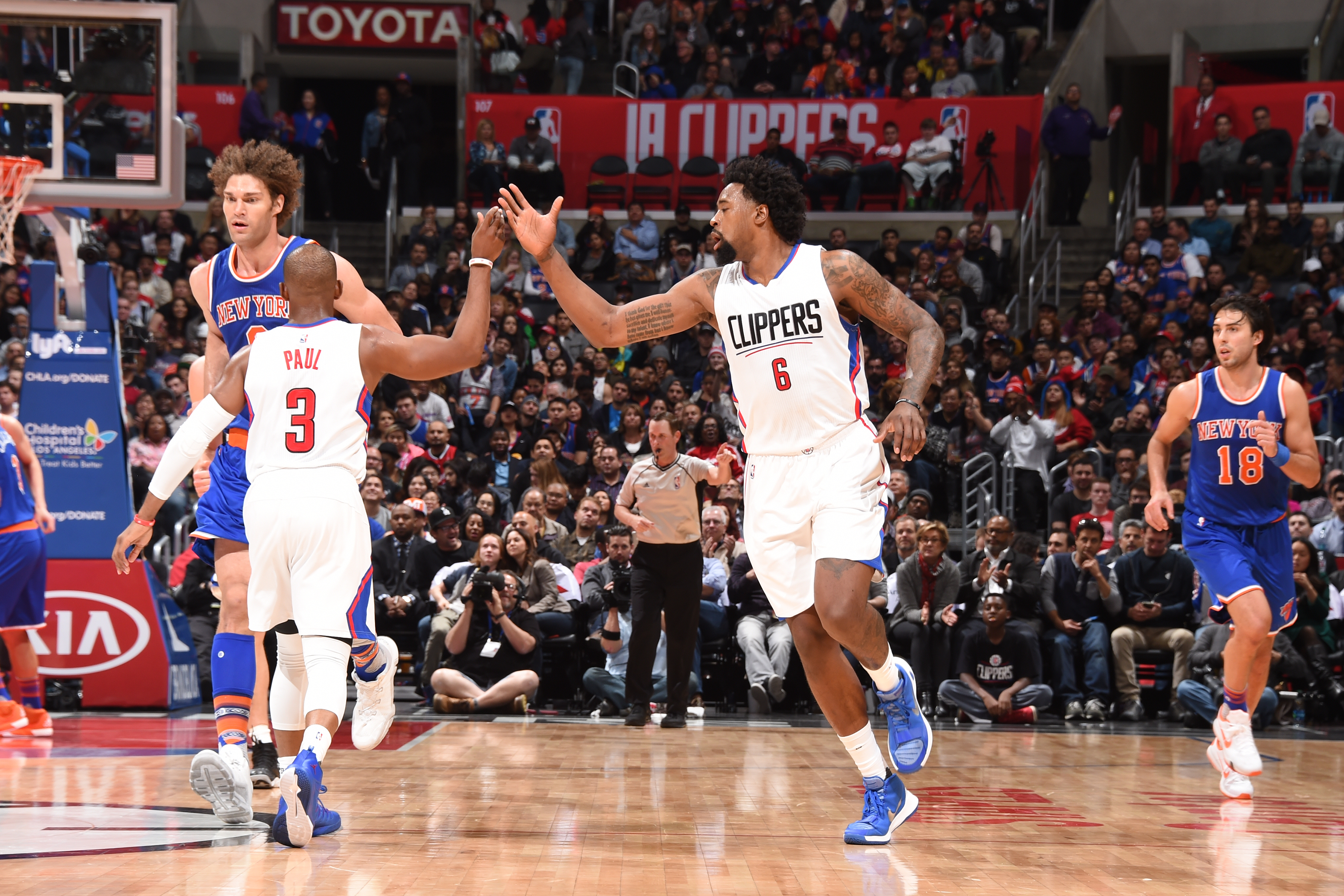LOS ANGELES, CA - MARCH 11:  DeAndre Jordan #6 of the Los Angeles Clippers shakes hands with Chris Paul #3 of the Los Angeles Clippers during the game against the New York Knicks on March 11, 2016 at STAPLES Center in Los Angeles, California. (Photo by An