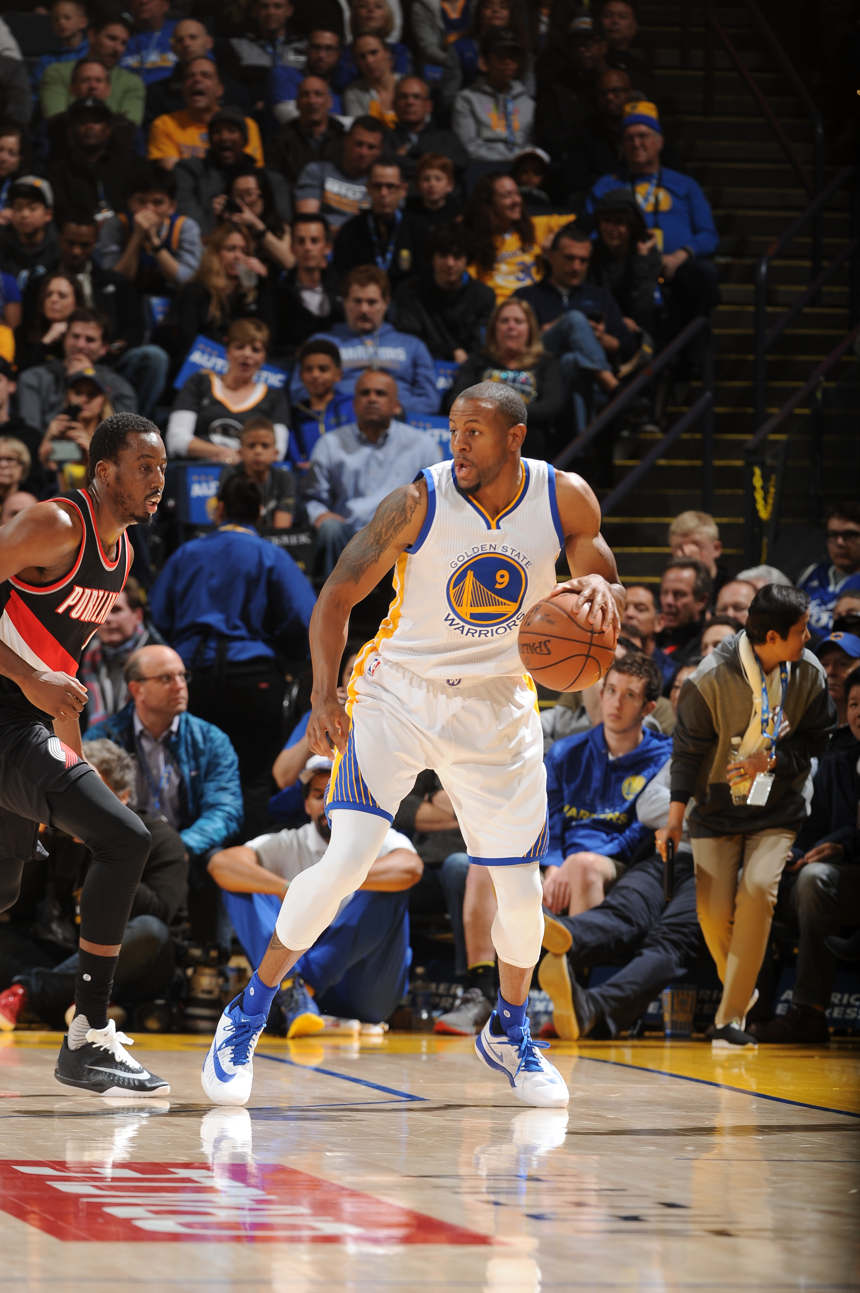OAKLAND, CA - MARCH 11:  Andre Iguodala #9 of the Golden State Warriors handles the ball against the Portland Trail Blazers on March 11, 2016 at Oracle Arena in Oakland, California. (Photo by Noah Graham/NBAE via Getty Images)