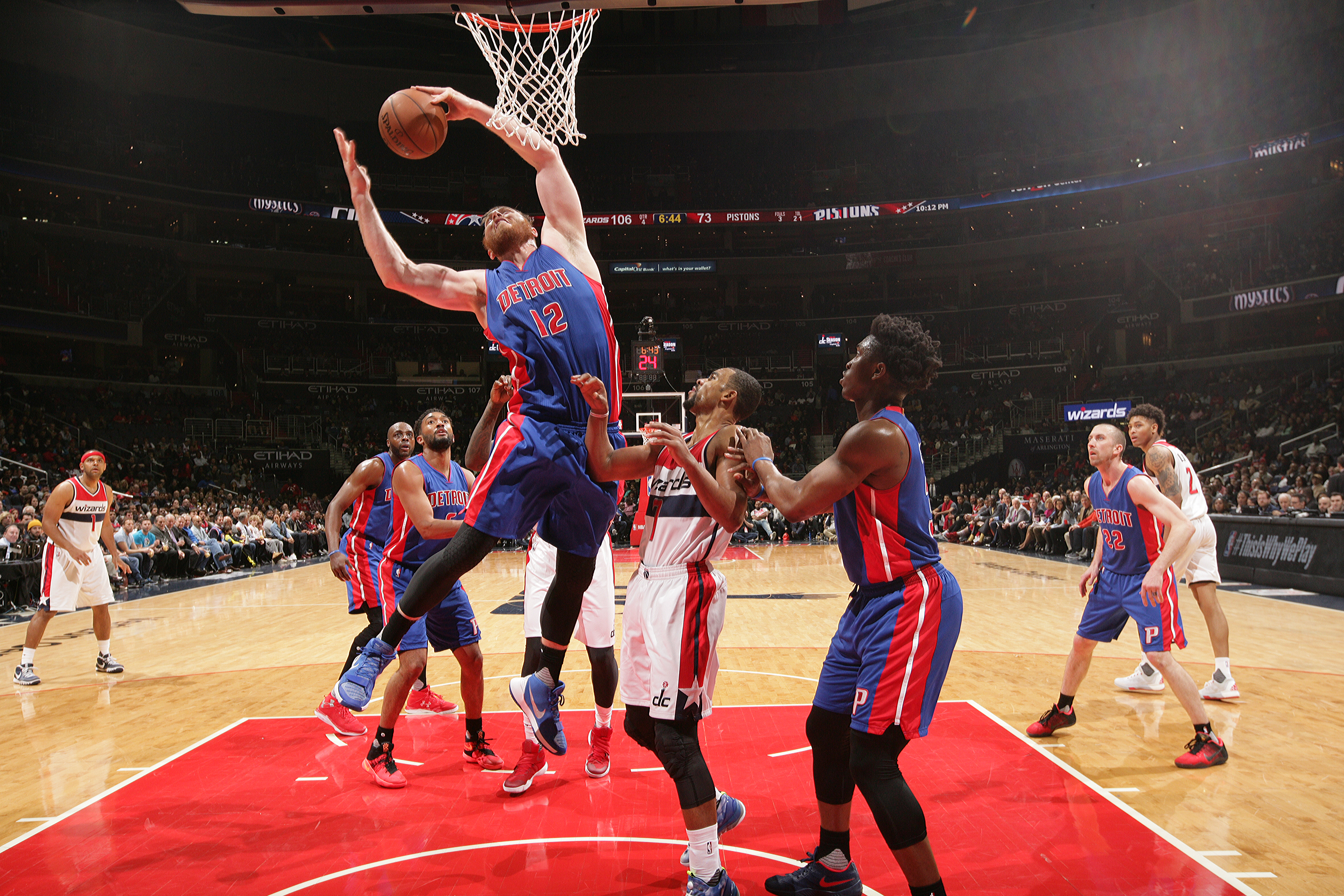 WASHINGTON, DC - MARCH 14: Aron Baynes #12 of the Detroit Pistons grabs the rebound against the Washington Wizards on March 14, 2016 at Verizon Center in Washington, DC. (Photo by Ned Dishman/NBAE via Getty Images)