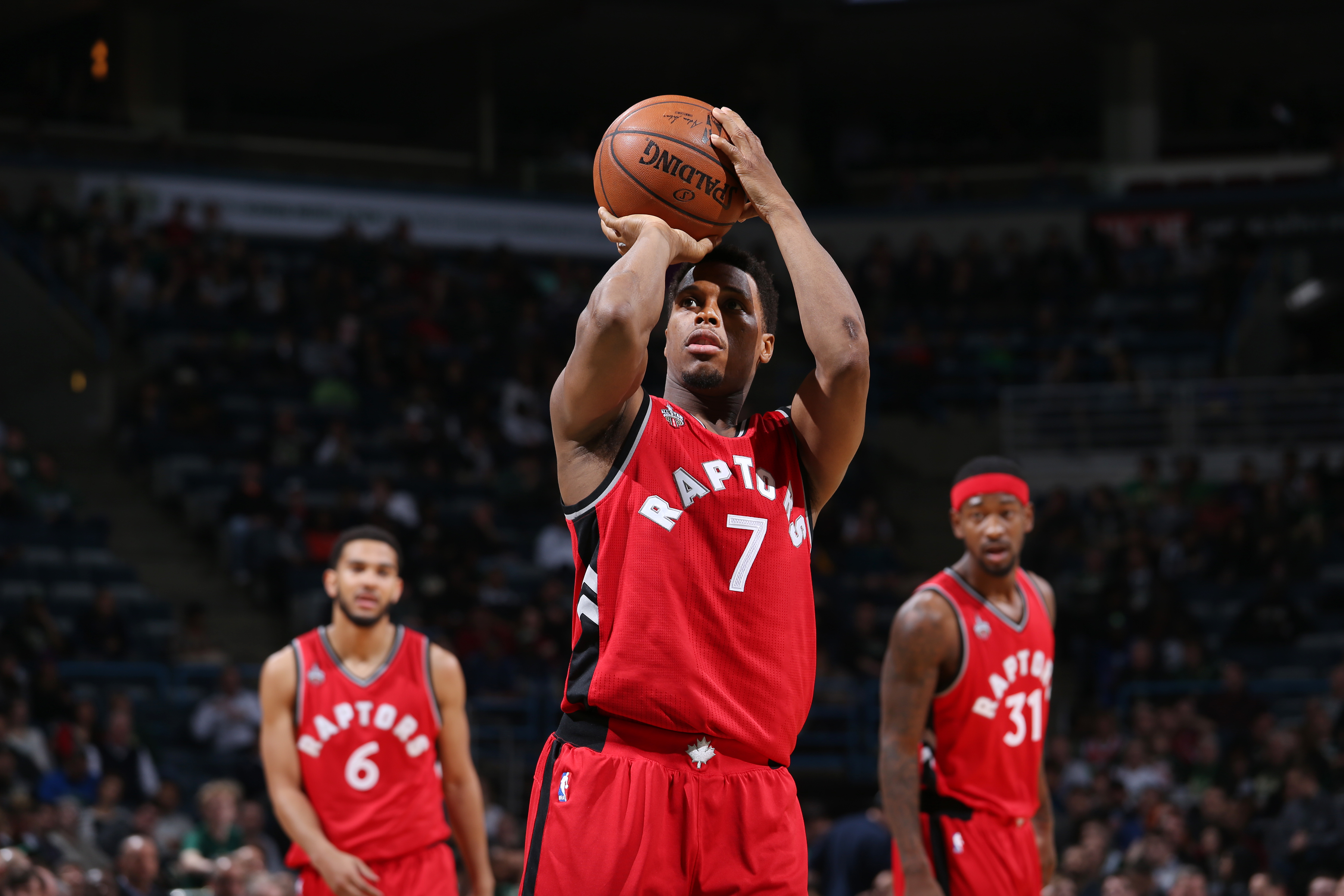 Milwaukee, WI - MARCH 15:  Kyle Lowry #7 of the Toronto Raptors shoots a free throw against the Milwaukee Bucks on March 15, 2016 at the BMO Harris Bradley Center in Milwaukee, Wisconsin. (Photo by Gary Dineen/NBAE via Getty Images)
