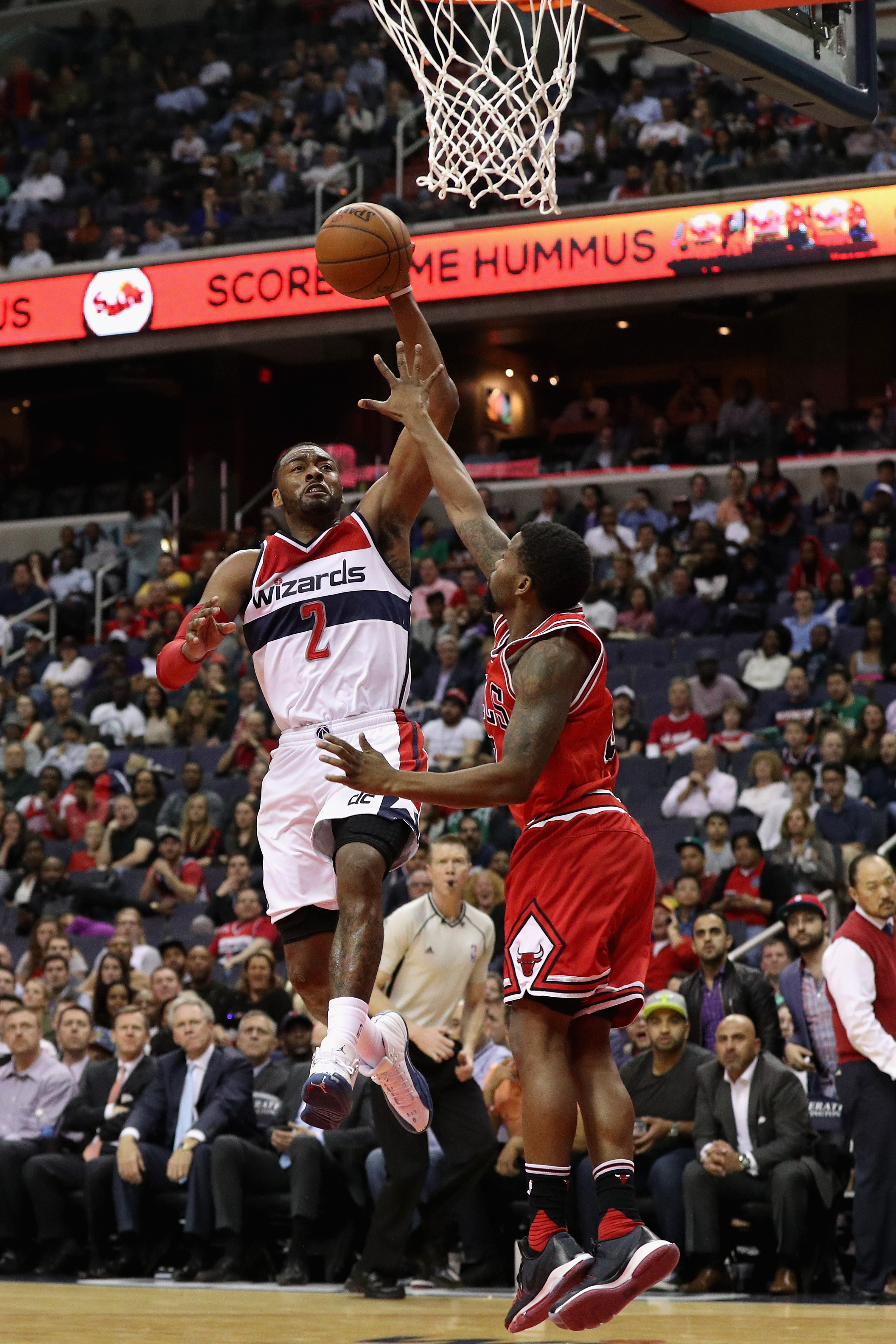 WASHINGTON, DC - MARCH 16: John Wall #2 of the Washington Wizards puts up a shot over Aaron Brooks #0 of the Chicago Bulls in the second half at Verizon Center on March 16, 2016 in Washington, DC. (Photo by Rob Carr/Getty Images)