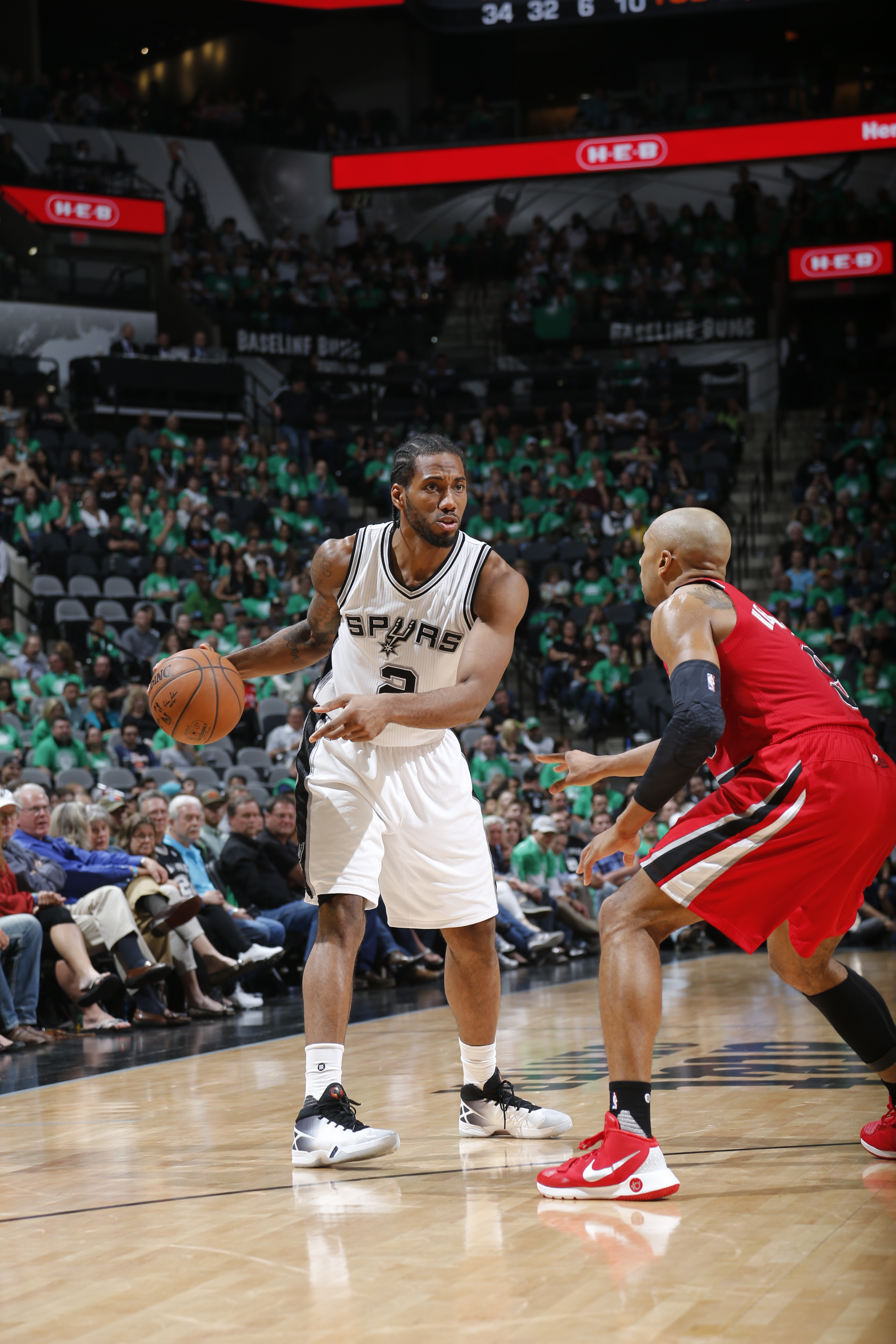 SAN ANTONIO, TX - MARCH 17:  Kawhi Leonard #2 of the San Antonio Spurs handles the ball against the Portland Trail Blazers on March 17, 2016 at the AT&T Center in San Antonio, Texas.