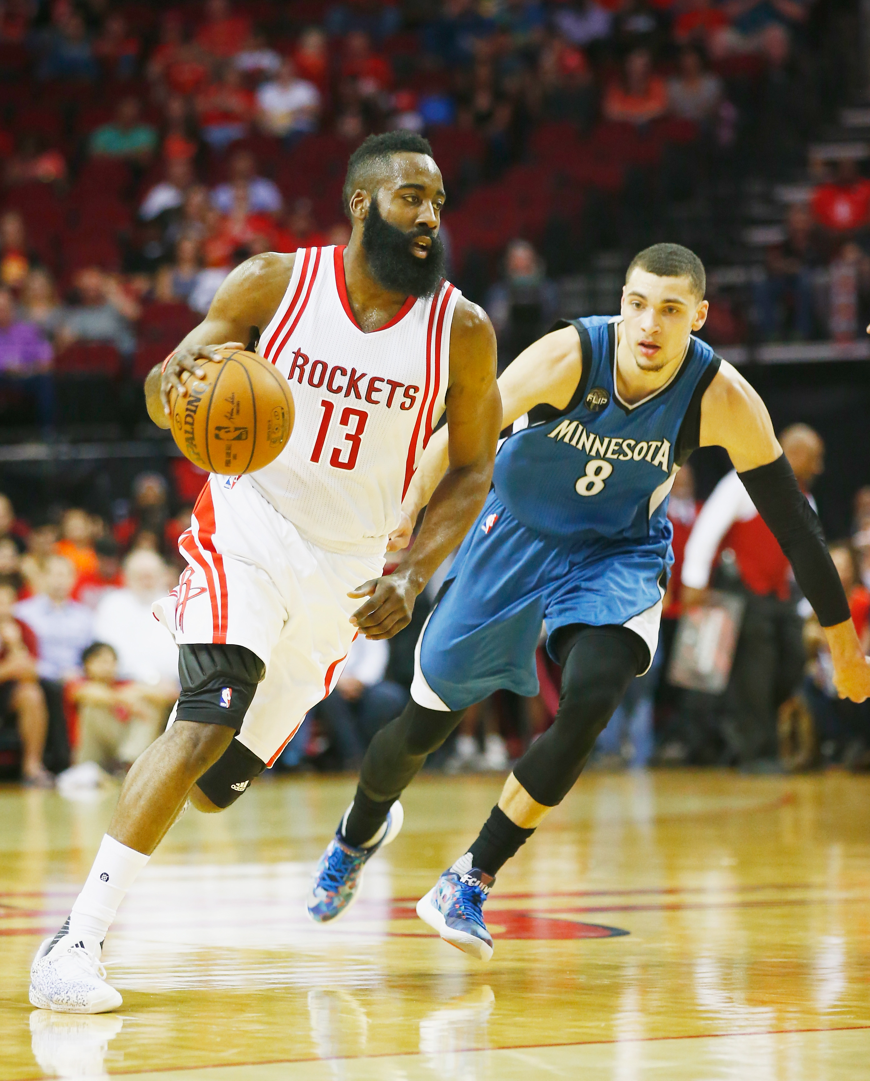 HOUSTON, TX - MARCH 18:  James Harden #13 of the Houston Rockets  drives with the basketball against Zach LaVine #8 of the Minnesota Timberwolves during their game at the Toyota Center on March 18, 2016 in Houston, Texas.  (Photo by Scott Halleran/Getty I