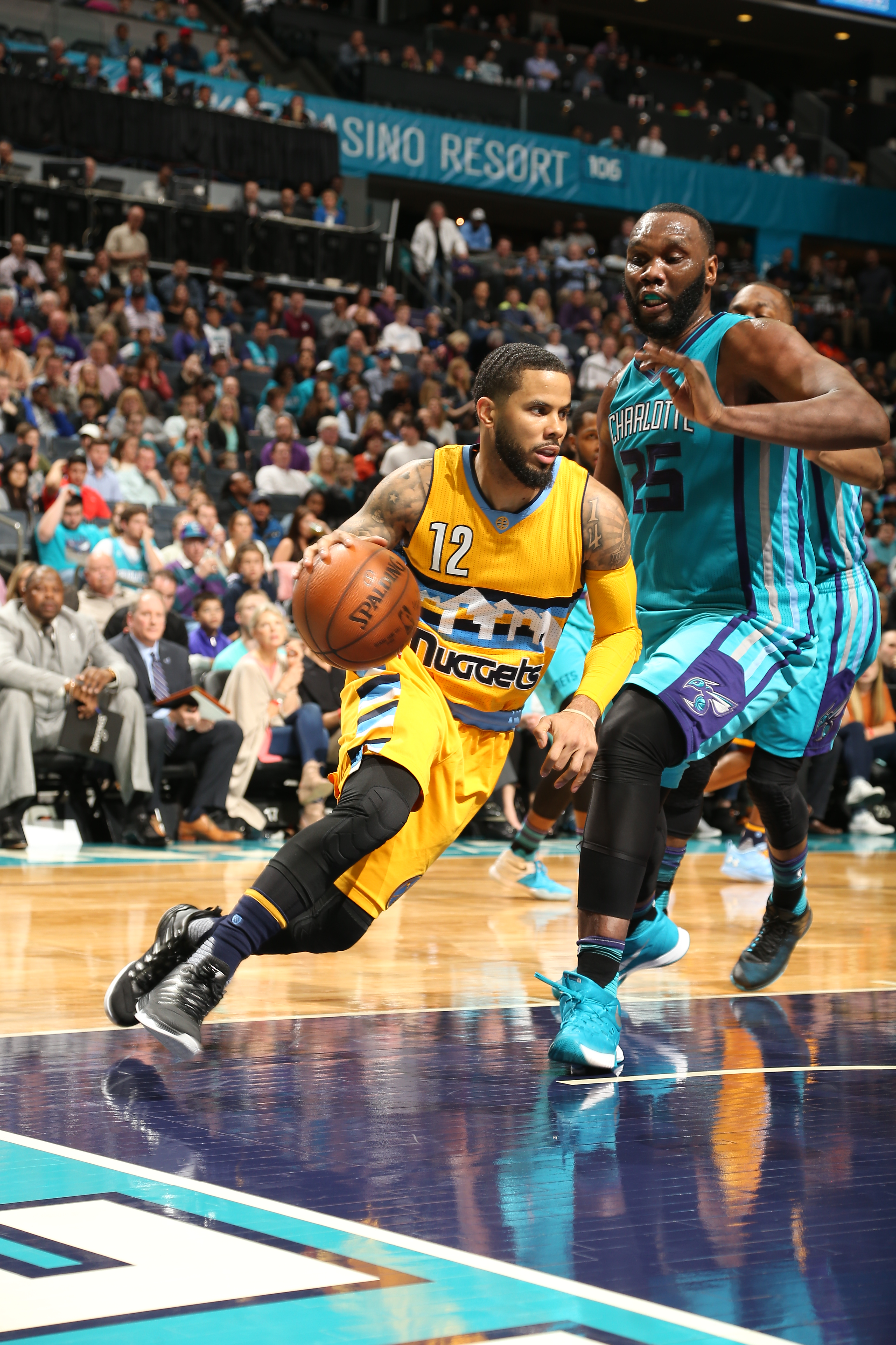 CHARLOTTE, NC - MARCH 19:  D.J. Augustin #12 of the Denver Nuggets handles the ball against the Charlotte Hornets on March 19, 2016 at Time Warner Cable Arena in Charlotte, North Carolina. (Photo by Kent Smith/NBAE via Getty Images)