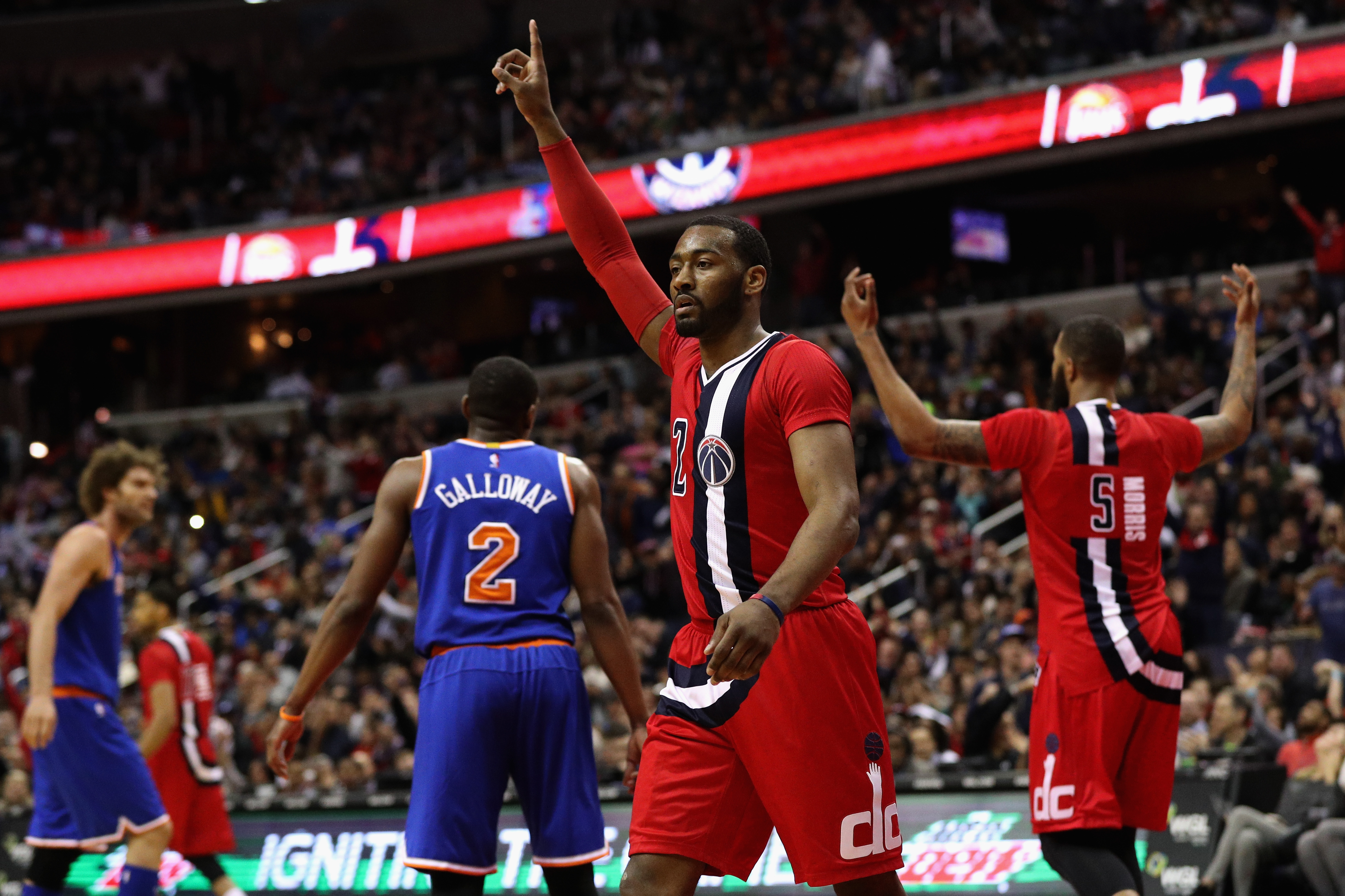 WASHINGTON, DC - MARCH 19: John Wall #2 of the Washington Wizards celebrates after the Wizards scored in the closing mintues of their 99-89 win over the New York Knicks at Verizon Center on March 19, 2016 in Washington, DC. (Photo by Rob Carr/Getty Images