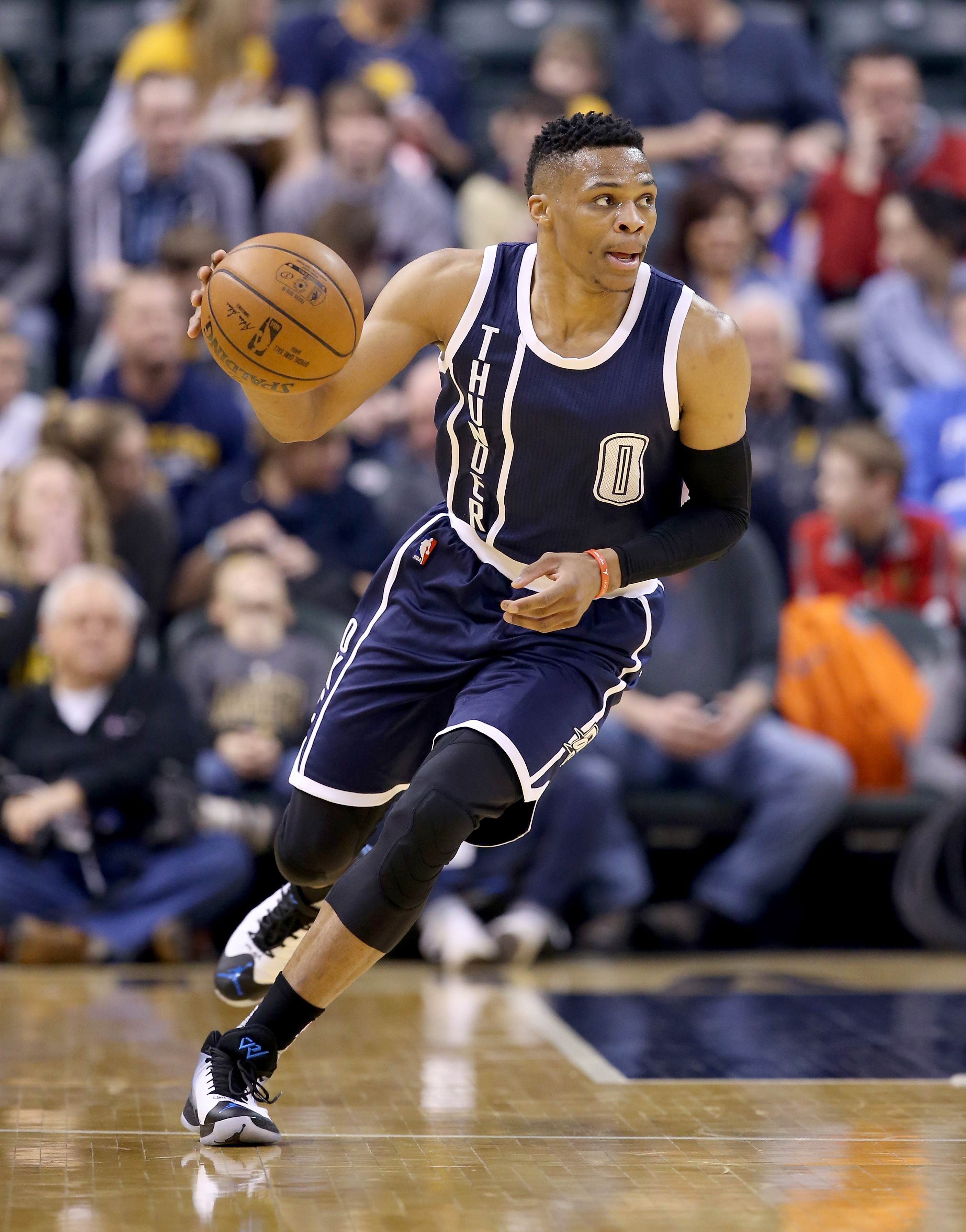 INDIANAPOLIS, IN - MARCH 19:  Russell Westbrook #0 of the Oklahoma City Thunder dribbles the ball during the 115-111 win over the Indiana Pacers at Bankers Life Fieldhouse on March 19, 2016 in Indianapolis, Indiana.   (Photo by Andy Lyons/Getty Images)