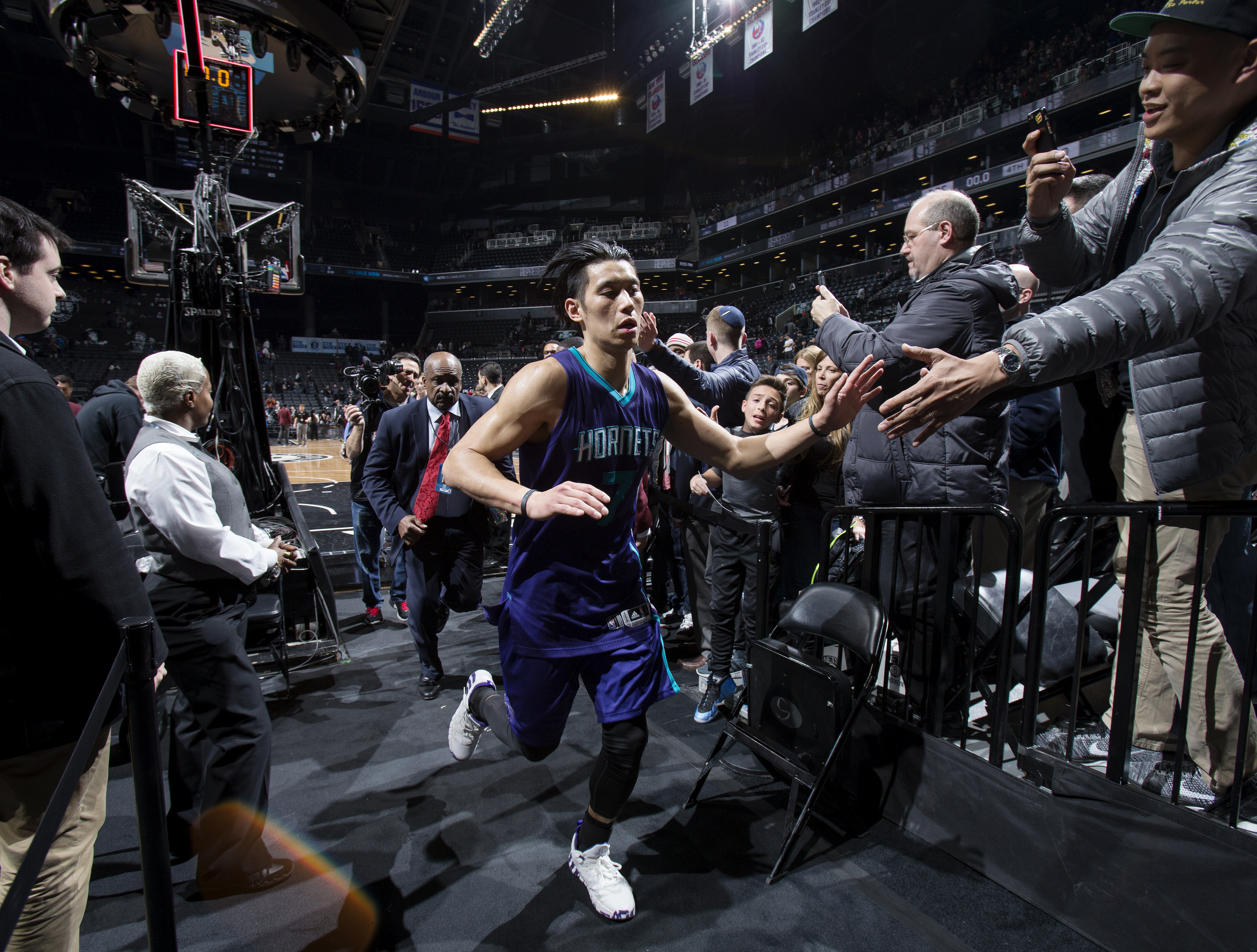 BROOKLYN, NY  - MARCH 22: Jeremy Lin #7 of the Charlotte Hornets high fives fans after the game against the Brooklyn Nets on March 22, 2016 at Barclays Center in Brooklyn, New York. (Photo by Nathaniel S. Butler/NBAE via Getty Images)
