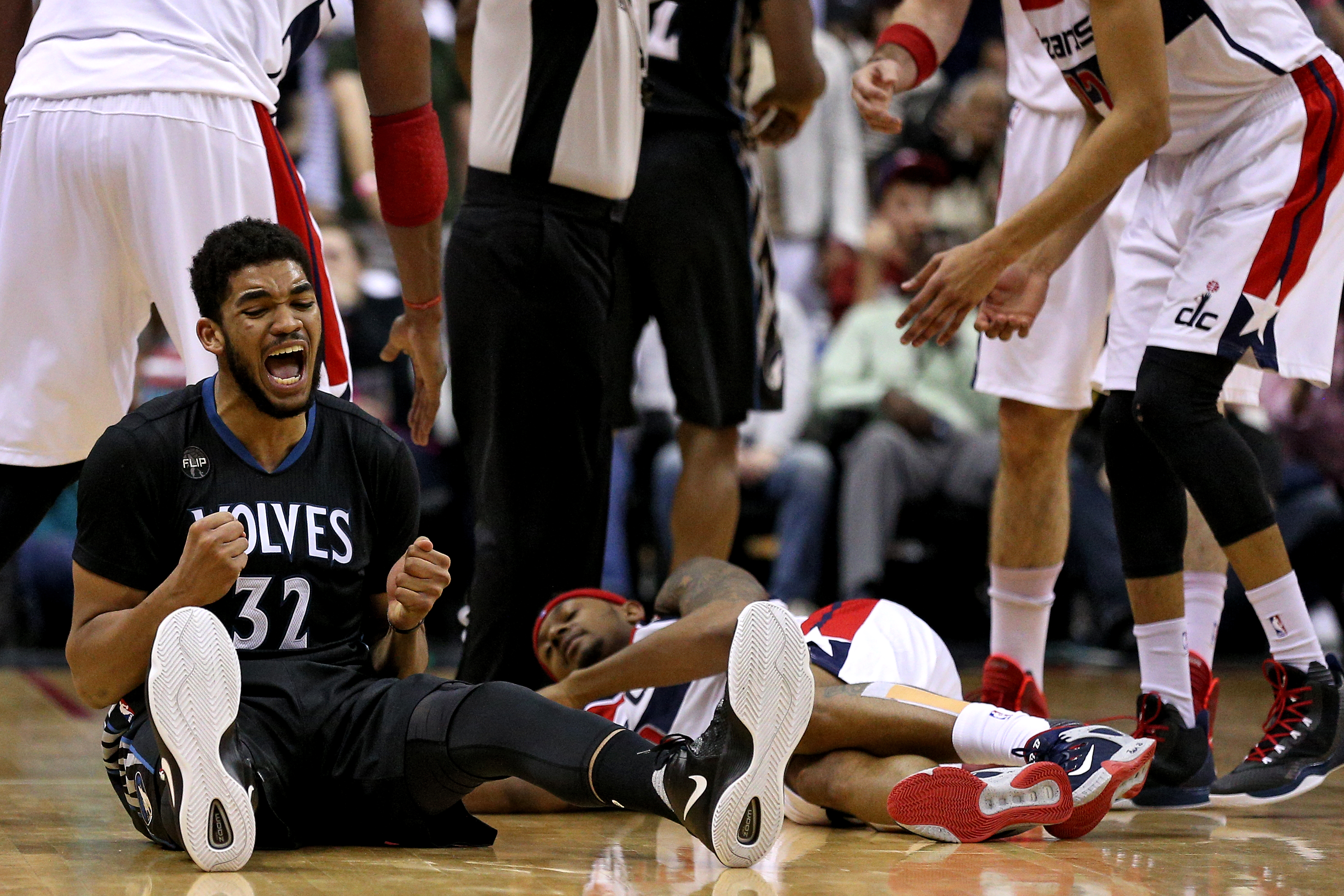 WASHINGTON, DC - MARCH 25: Karl-Anthony Towns #32 of the Minnesota Timberwolves reacts in the first overtime against the Washington Wizards at Verizon Center on March 25, 2016 in Washington, DC. The Minnesota Timberwolves won, 132-129, in double overtime.
