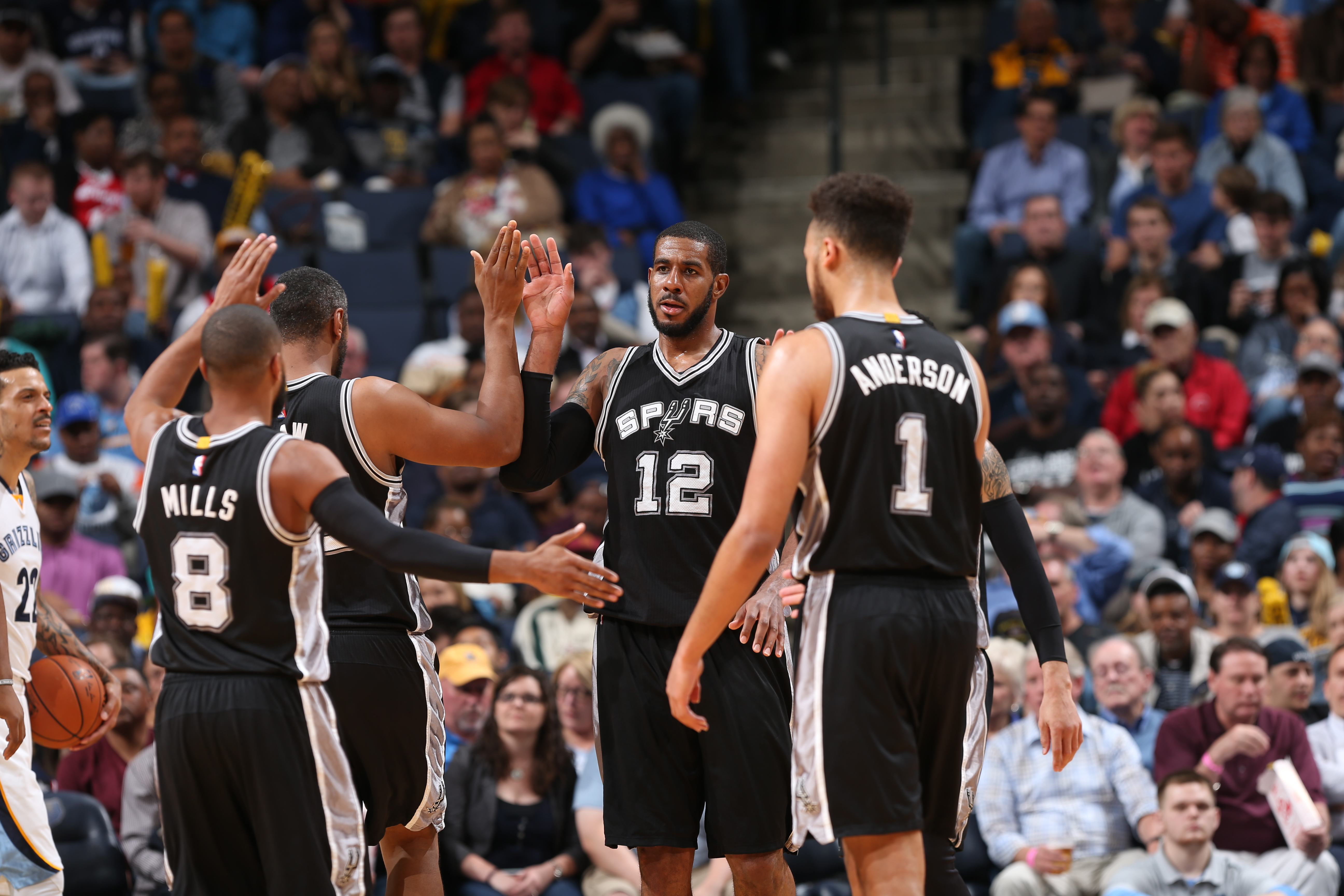 MEMPHIS, TN - MARCH 28:  LaMarcus Aldridge #12 of the San Antonio Spurs shakes hands with his teammates during the game against the Memphis Grizzlies on March 28, 2016 at FedExForum in Memphis, Tennessee. (Photo by Joe Murphy/NBAE via Getty Images)