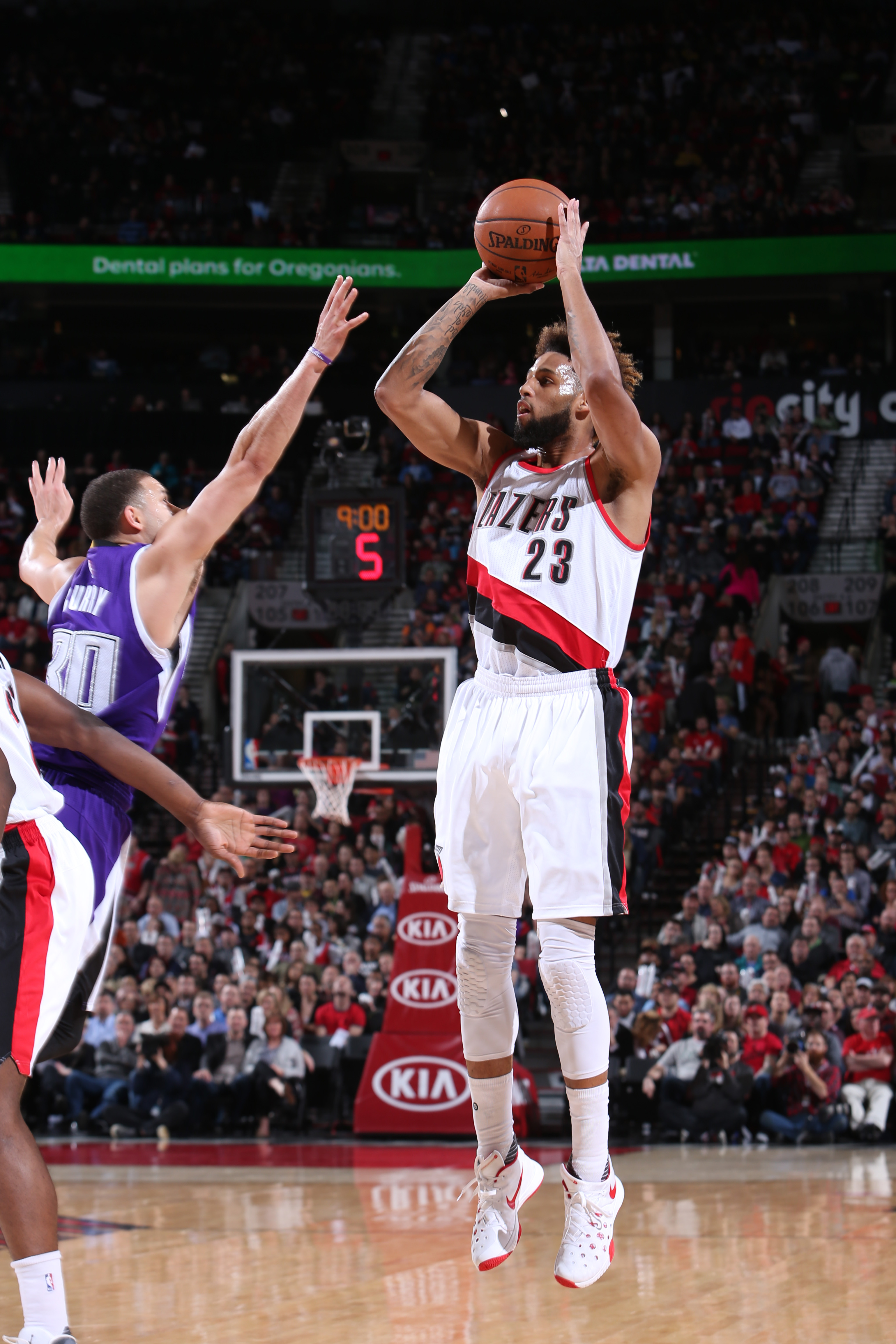 PORTLAND, OR  - MARCH 28: Allen Crabbe #23 of the Portland Trail Blazers shoots against the Sacramento Kings during the game on March 28, 2016 at Moda Center in Portland, Oregon. (Photo by Sam Forencich/NBAE via Getty Images)