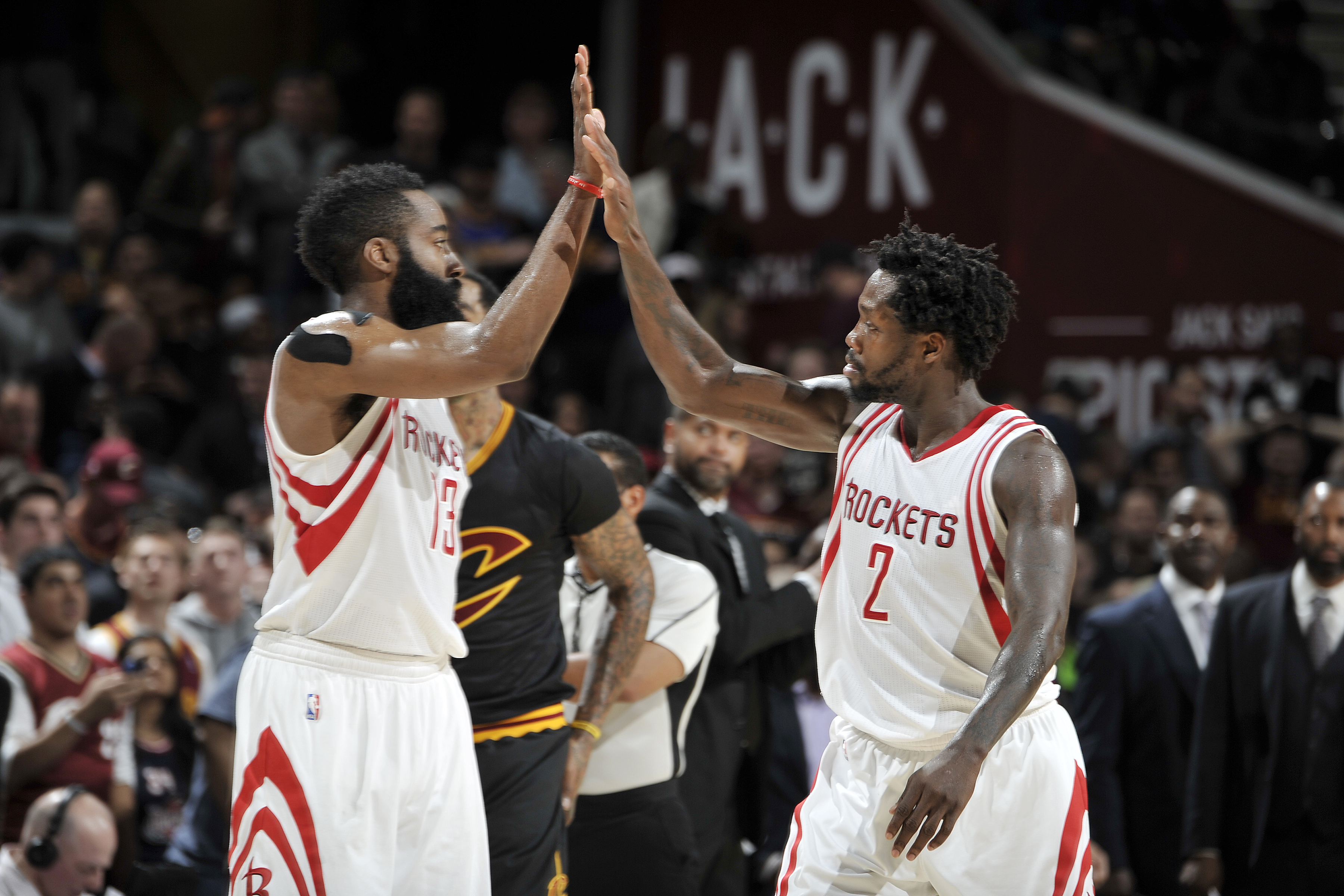 CLEVELAND, OH - MARCH 29:  James Harden #13 of the Houston Rockets shakes hands with Patrick Beverley #2 of the Houston Rockets during the game against the Cleveland Cavaliers on March 29, 2016 at Quicken Loans Arena in Cleveland, Ohio. (Photo by David Li