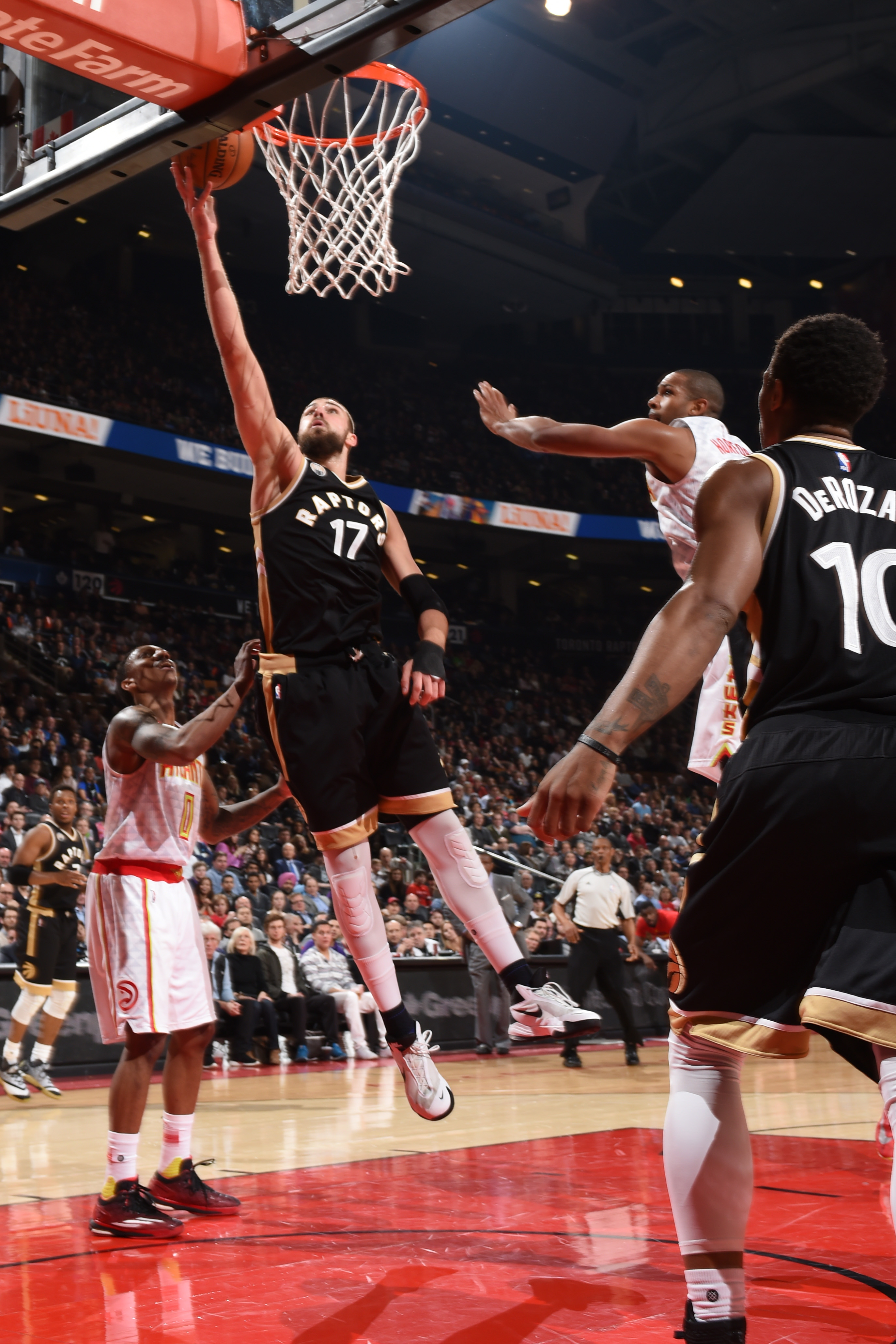 TORONTO, CAN  - MARCH 30: Jonas Valanciunas #17 of the Toronto Raptors goes for the lay up against the Atlanta Hawks during the game on March 30, 2016 at Air Canada Centre in Toronto, Canada. (Photo by Ron Turenne/NBAE via Getty Images)