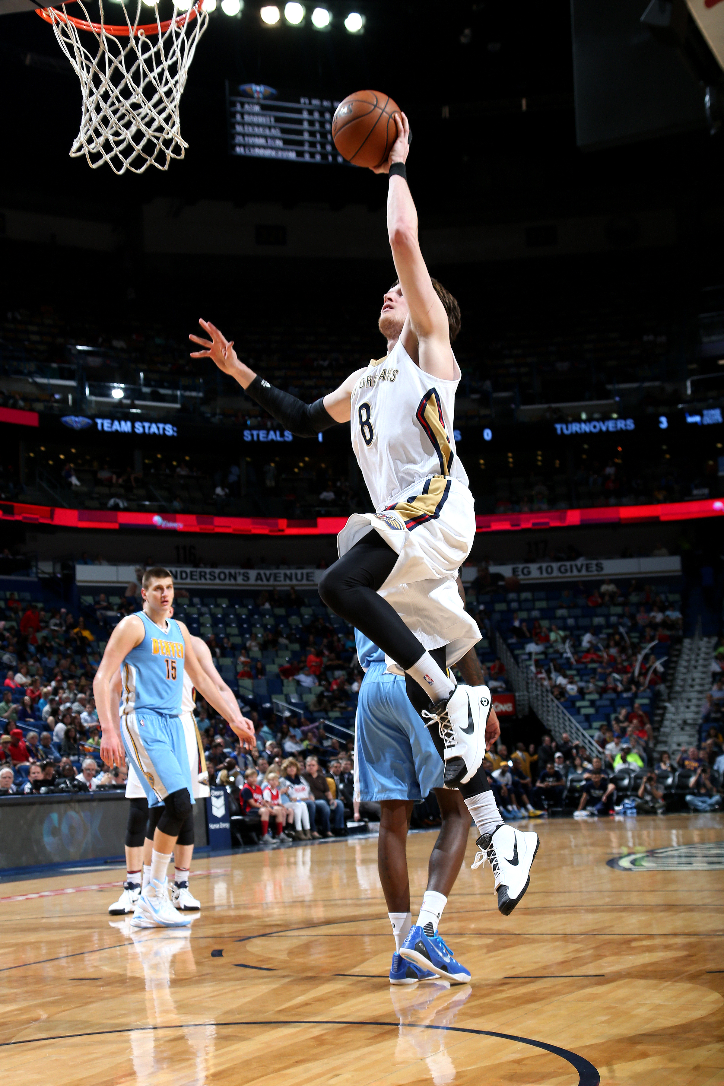 NEW ORLEANS, LA - MARCH 31: Luke Babbitt #8 of the New Orleans Pelicans goes for the lay up during the game against the Denver Nuggets on March 31, 2016 at the Smoothie King Center in New Orleans, Louisiana. (Photo by Layne Murdoch Jr./NBAE via Getty Imag