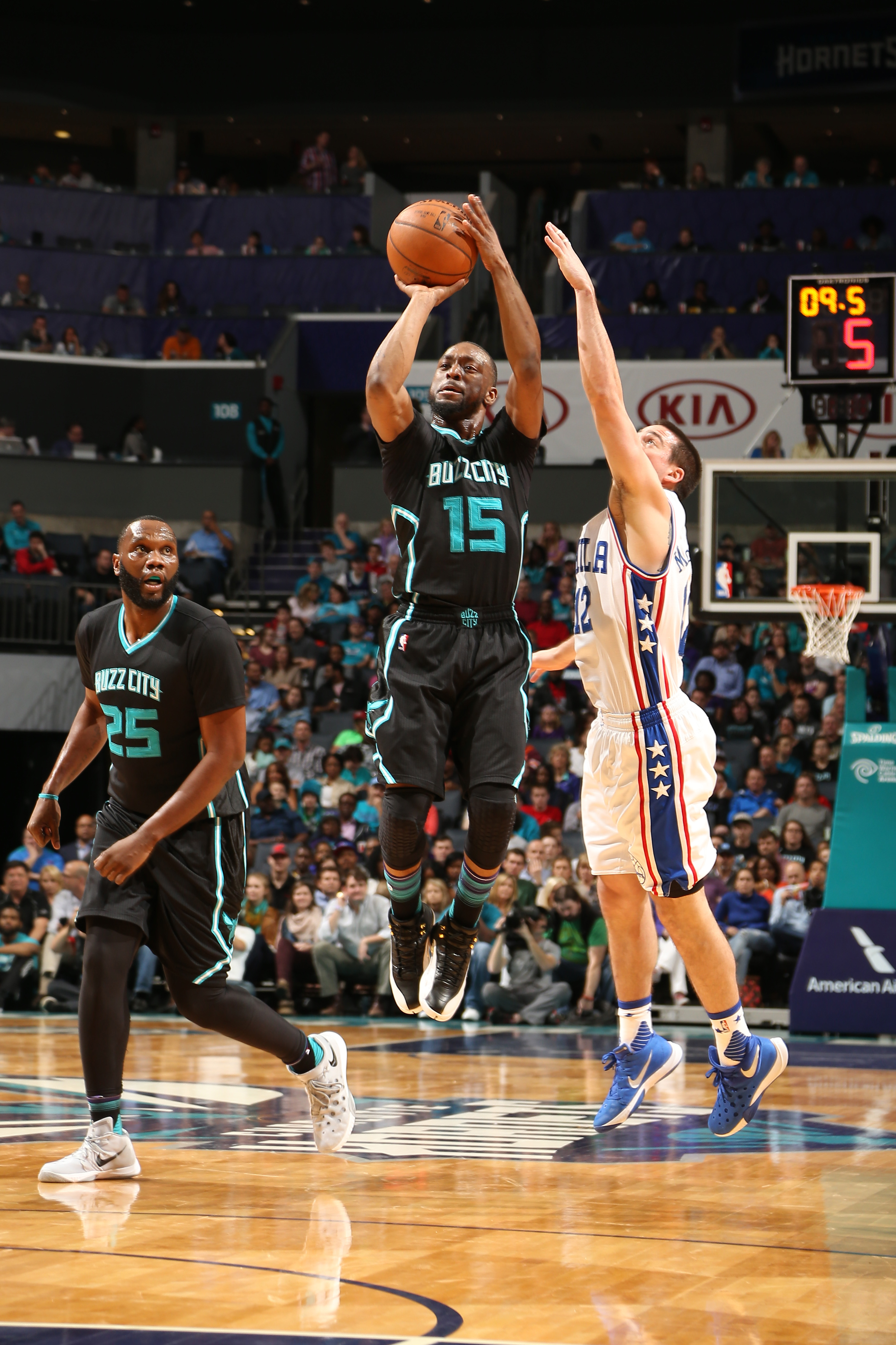 CHARLOTTE, NC  - APRIL 1: Kemba Walker #15 of the Charlotte Hornets shoots against the Philadelphia 76ers during the game on April 1, 2016 at Time Warner Cable Arena in Charlotte, North Carolina. (Photo by Kent Smith/NBAE via Getty Images)