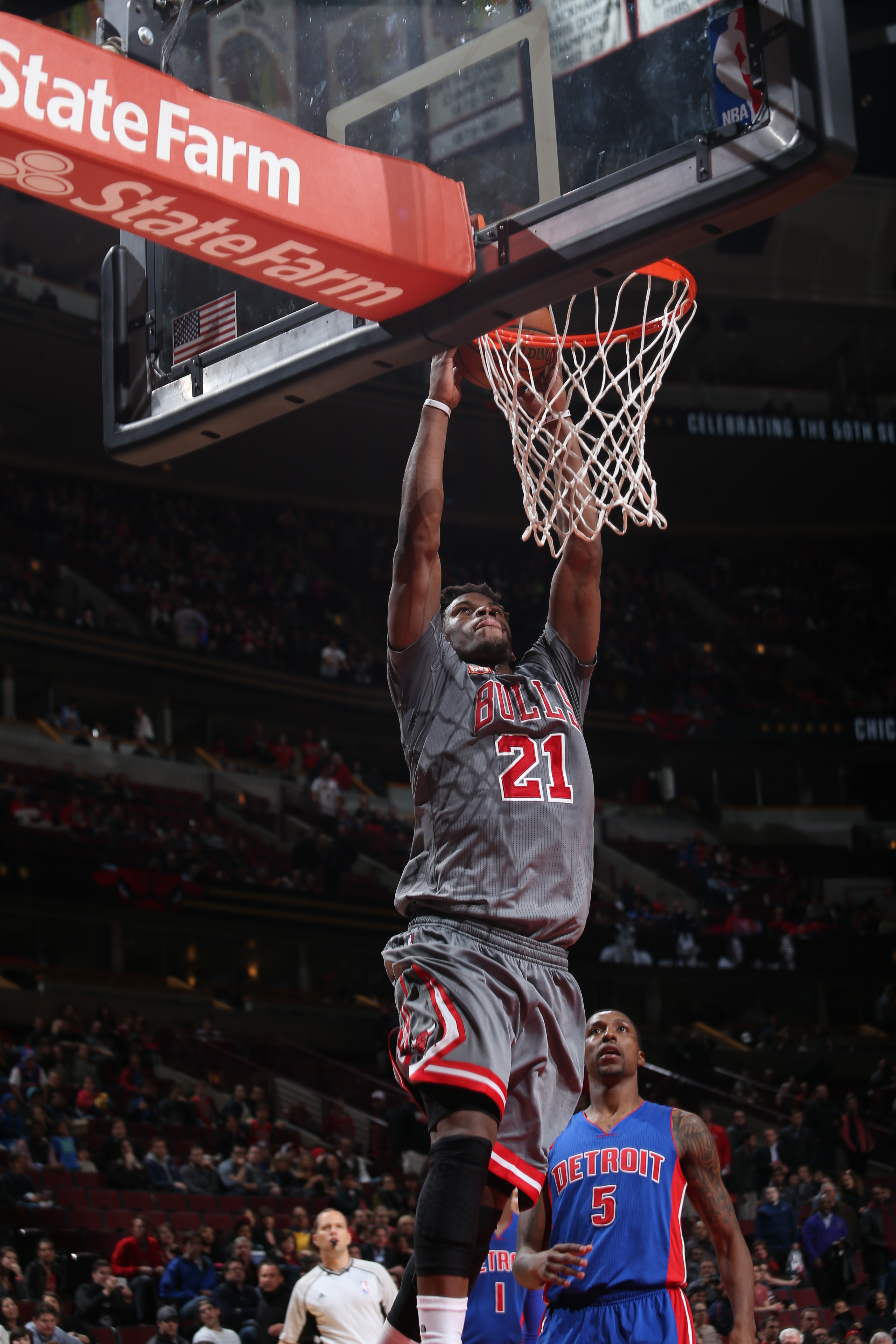 CHICAGO, IL - APRIL 2:  Jimmy Butler #21 of the Chicago Bulls goes to the basket against the Detroit Pistons on April 2, 2016 at the United Center in Chicago, Illinois. (Photo by Gary Dineen/NBAE via Getty Images)
