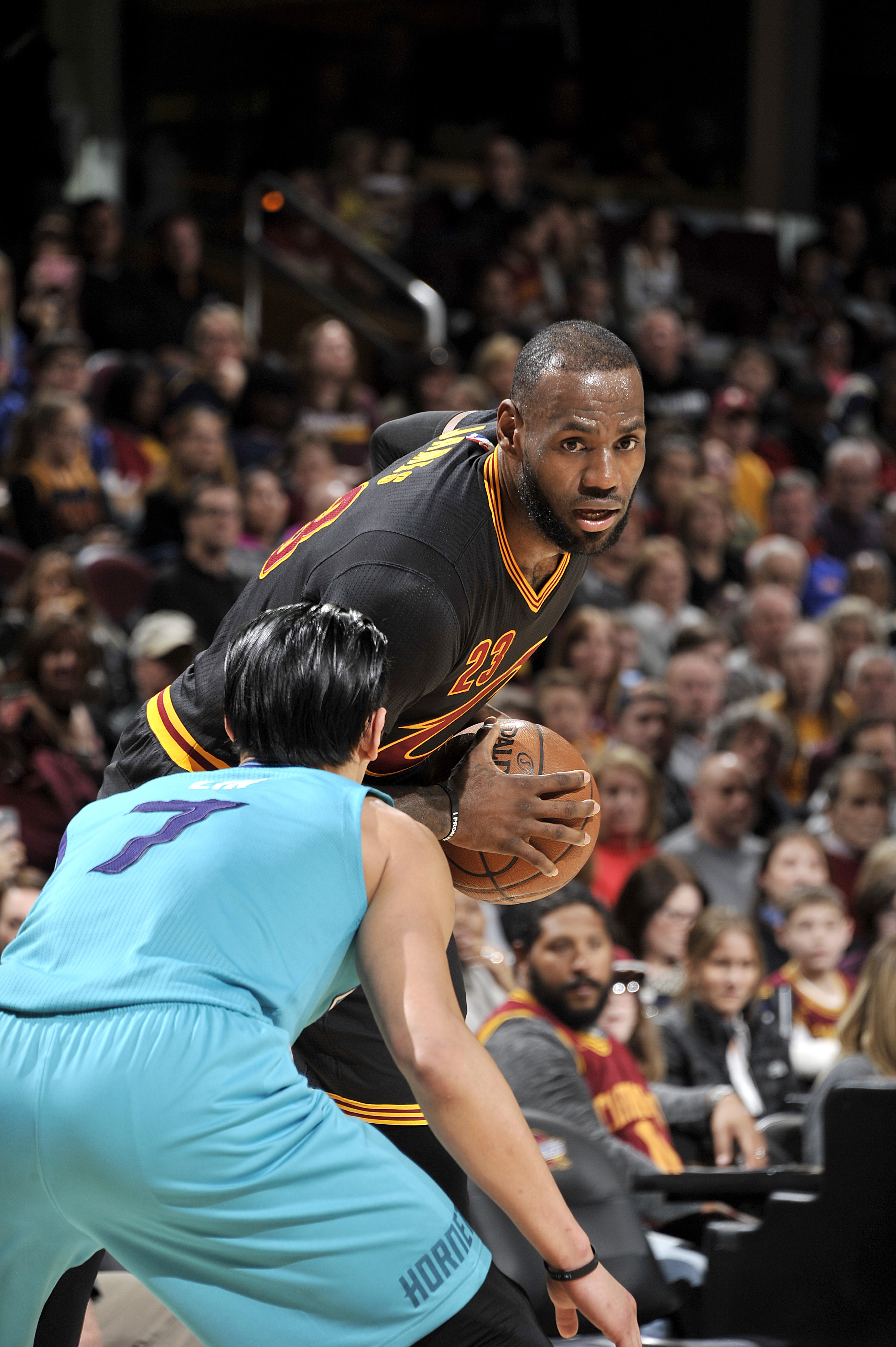 CLEVELAND, OH - APRIL 3: LeBron James #23 of the Cleveland Cavaliers handles the ball during the game against Jeremy Lin #7 of the Charlotte Hornets on April 3, 2016 at Quicken Loans Arena in Cleveland, Ohio.  (Photo by David Liam Kyle/NBAE via Getty Imag