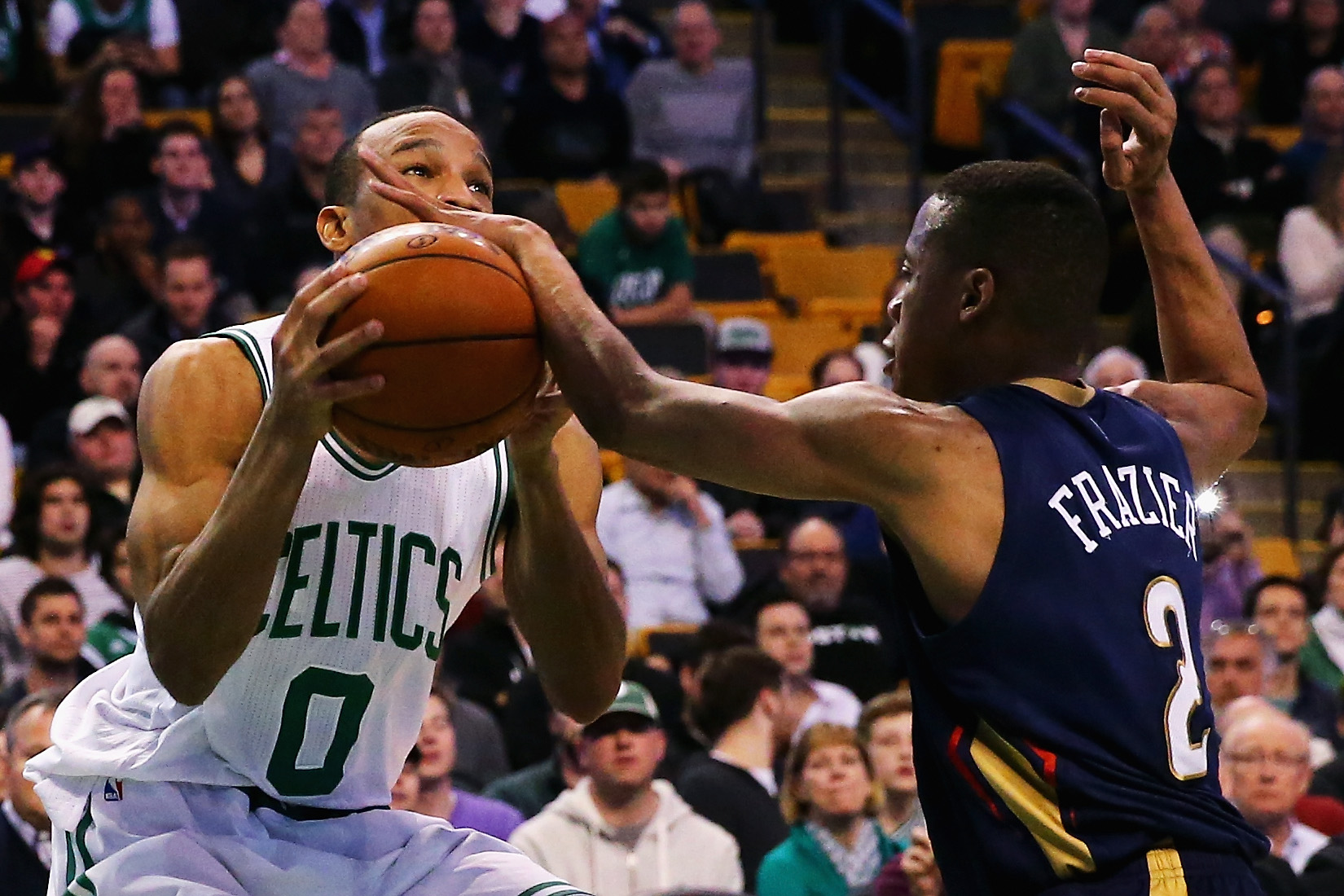 BOSTON, MASSACHUSETTS - APRIL 06:  Tim Frazier #2 of the New Orleans Pelicans blocks a shot by Avery Bradley #0 of the Boston Celtics during the fourth quarter at TD Garden on April 6, 2016 in Boston, Massachusetts. The Celtics defeat the Pelicans 104-97.