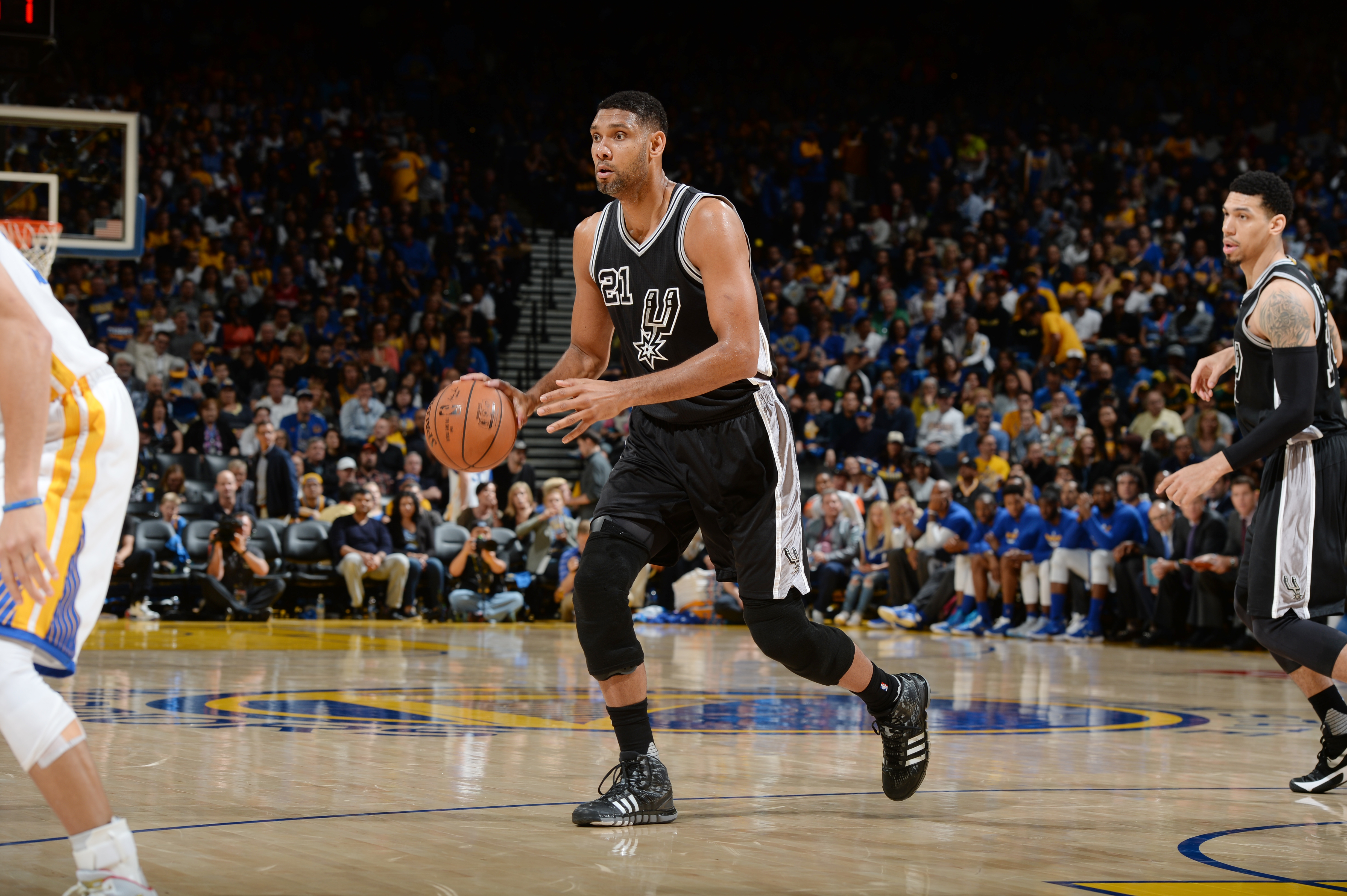 OAKLAND, CA - APRIL 7:  Tim Duncan #21 of the San Antonio Spurs handles the ball against the Golden State Warriors on April 7, 2016 at ORACLE Arena in Oakland, California. (Photo by Garrett Ellwood/NBAE via Getty Images)