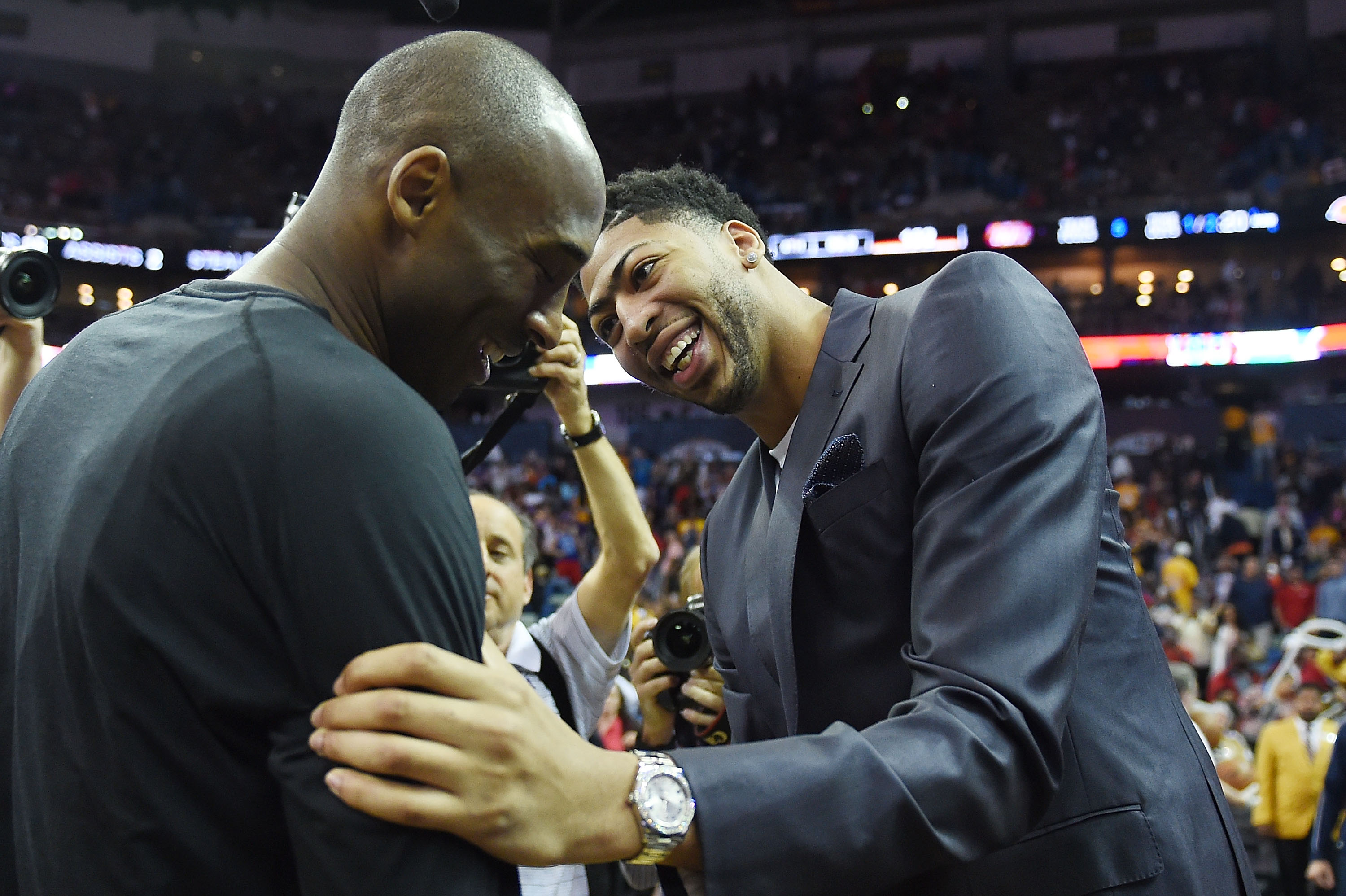 NEW ORLEANS, LA - APRIL 08:  Anthony Davis #23 of the New Orleans Pelicans embraces Kobe Bryant #24 of the Los Angeles Lakers following a game at the Smoothie King Center on April 8, 2016 in New Orleans, Louisiana. (Photo by Stacy Revere/Getty Images)