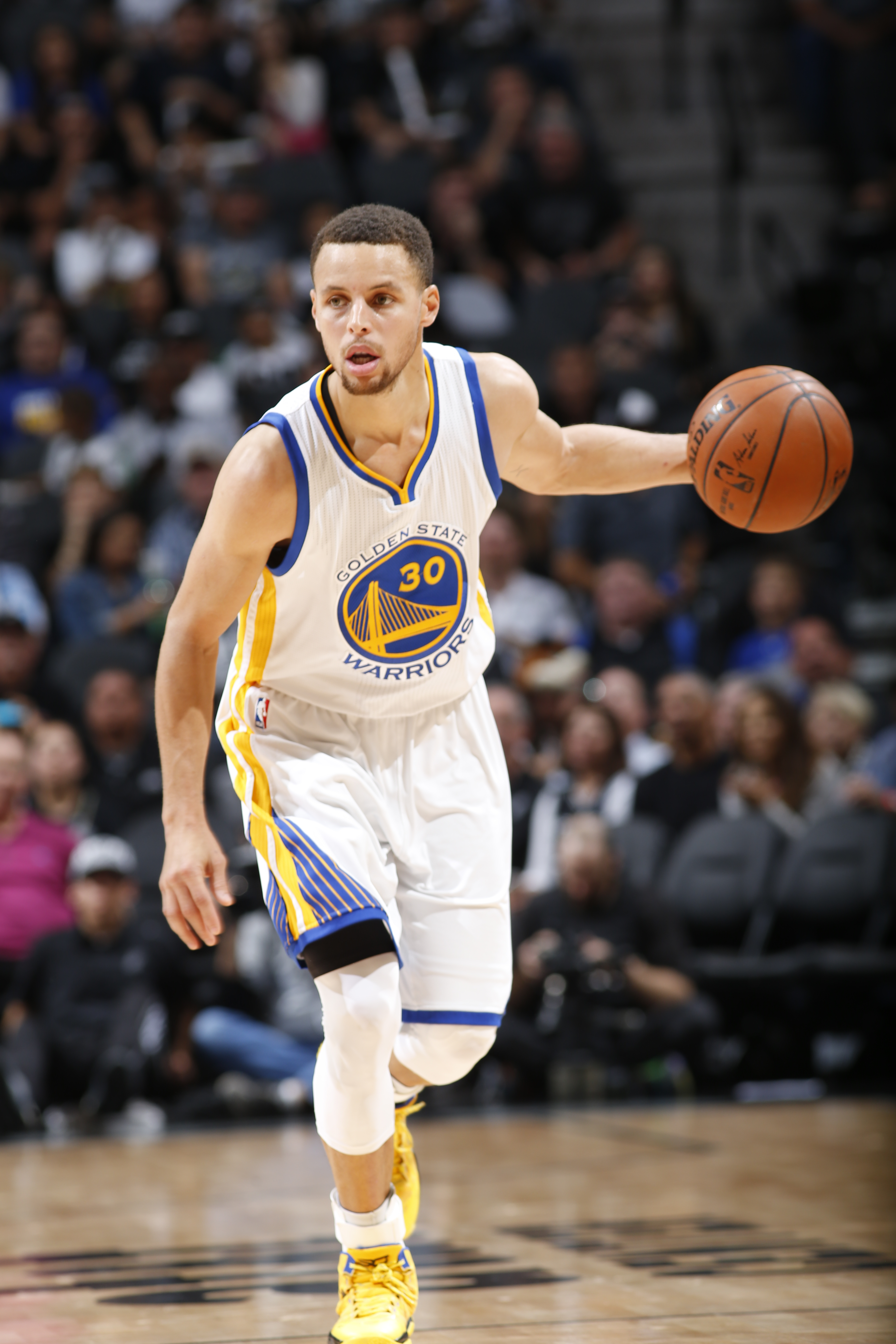 SAN ANTONIO, TX - APRIL 10:  Stephen Curry #30 of the Golden State Warriors handles the ball against the San Antonio Spurs on April 10, 2016 at the AT&T Center in San Antonio, Texas.